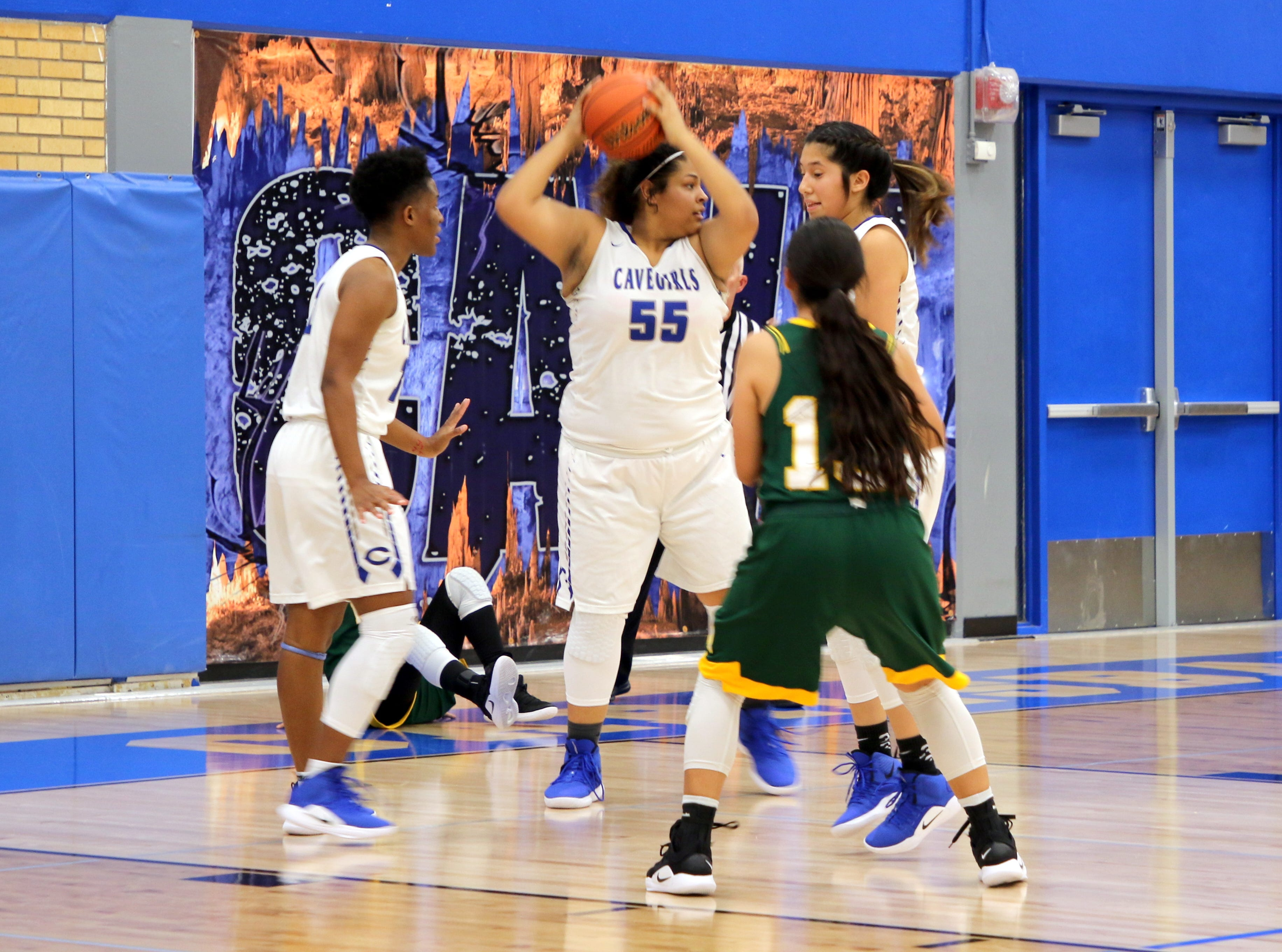 Carlsbad's Kaliyah Montoya (55) pulls down a rebound in the second half of Friday's game against Mayfield.