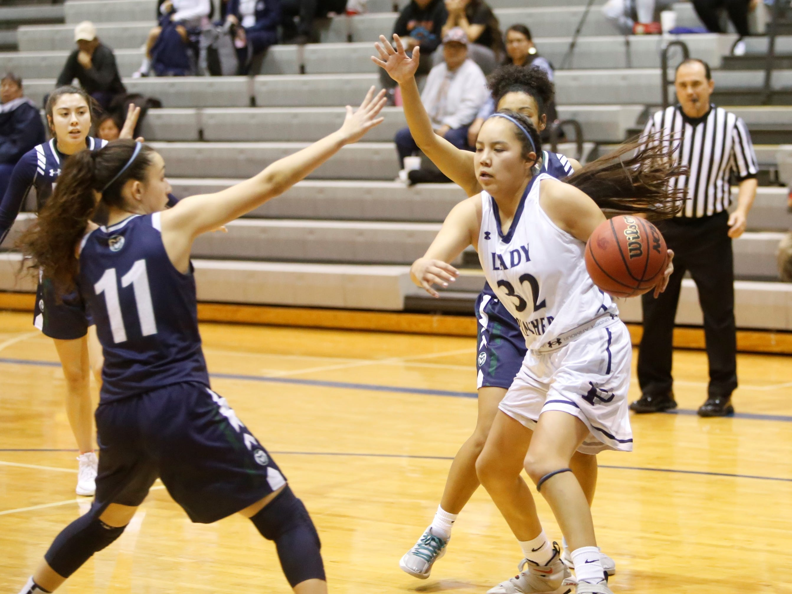 Piedra Vista's Lanae Billy drives along the baseline toward the basket against Rio Rancho during Saturday's game at Jerry A. Conner Fieldhouse in Farmington.