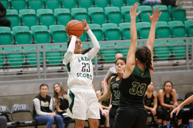 Farmington's Kiiyani Anitielu puts up a shot against Hope Christian's Hayley Valencia (33) during Friday's game at Scorpion Arena. Visit daily-times.com to see the latest sports photo galleries and video highlights.