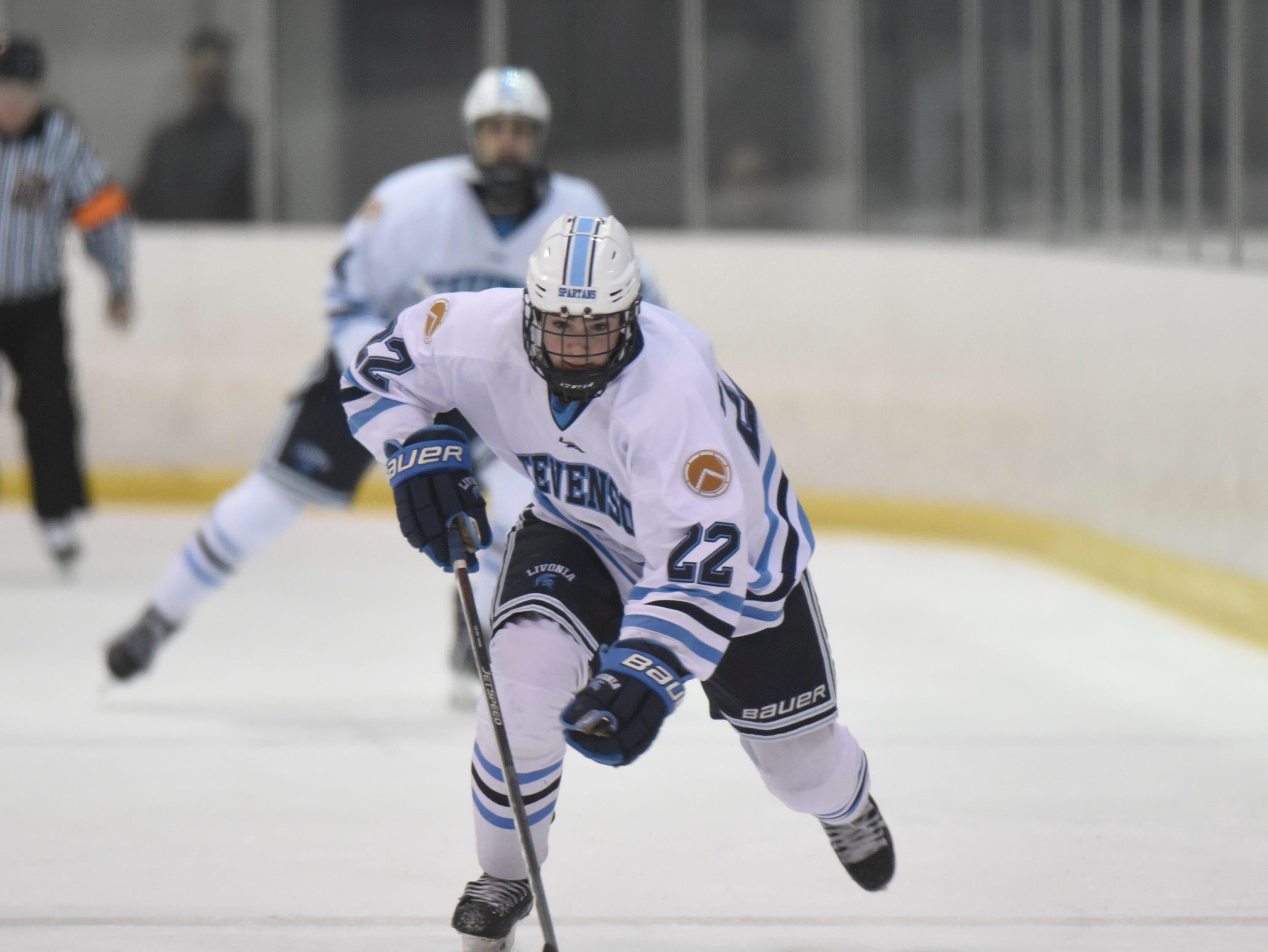 Stevenson forward Kosh Suzio (22) moves the puck up ice against Salem at Eddie Edgar Arena Jan. 4, 2019.