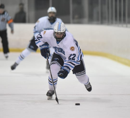 Livonia Stevenson forward Josh Suzio (22) moves the puck up ice against Salem in a KLAA game on Jan. 4 at Edgar Arena.