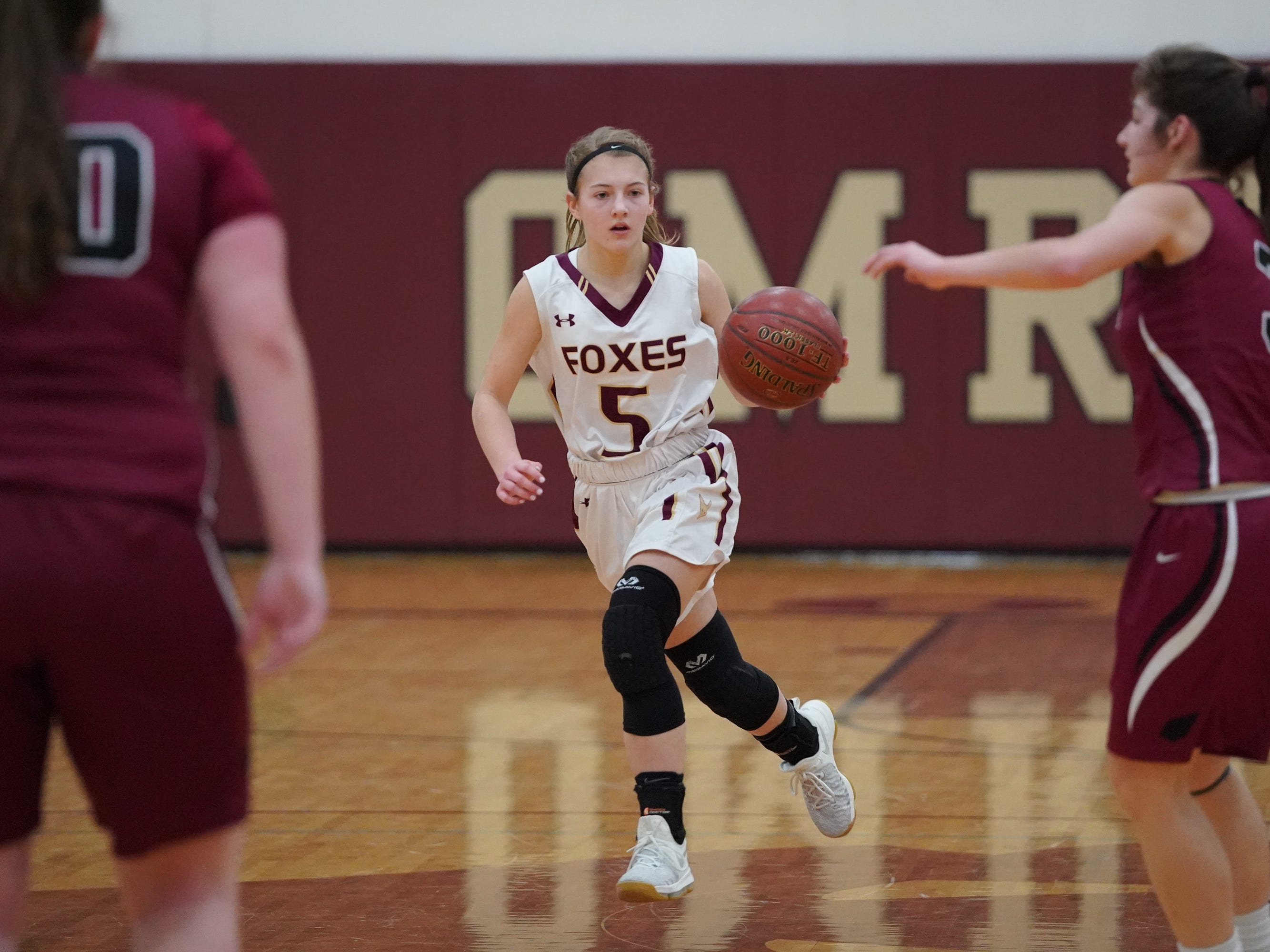 Hannah Fedderly (5) of Omro  brings the ball downcourt. The Omro Foxes hosted the Mayville Cardinals in a Flyway Conference basketball game Friday evening, January 4, 2019.