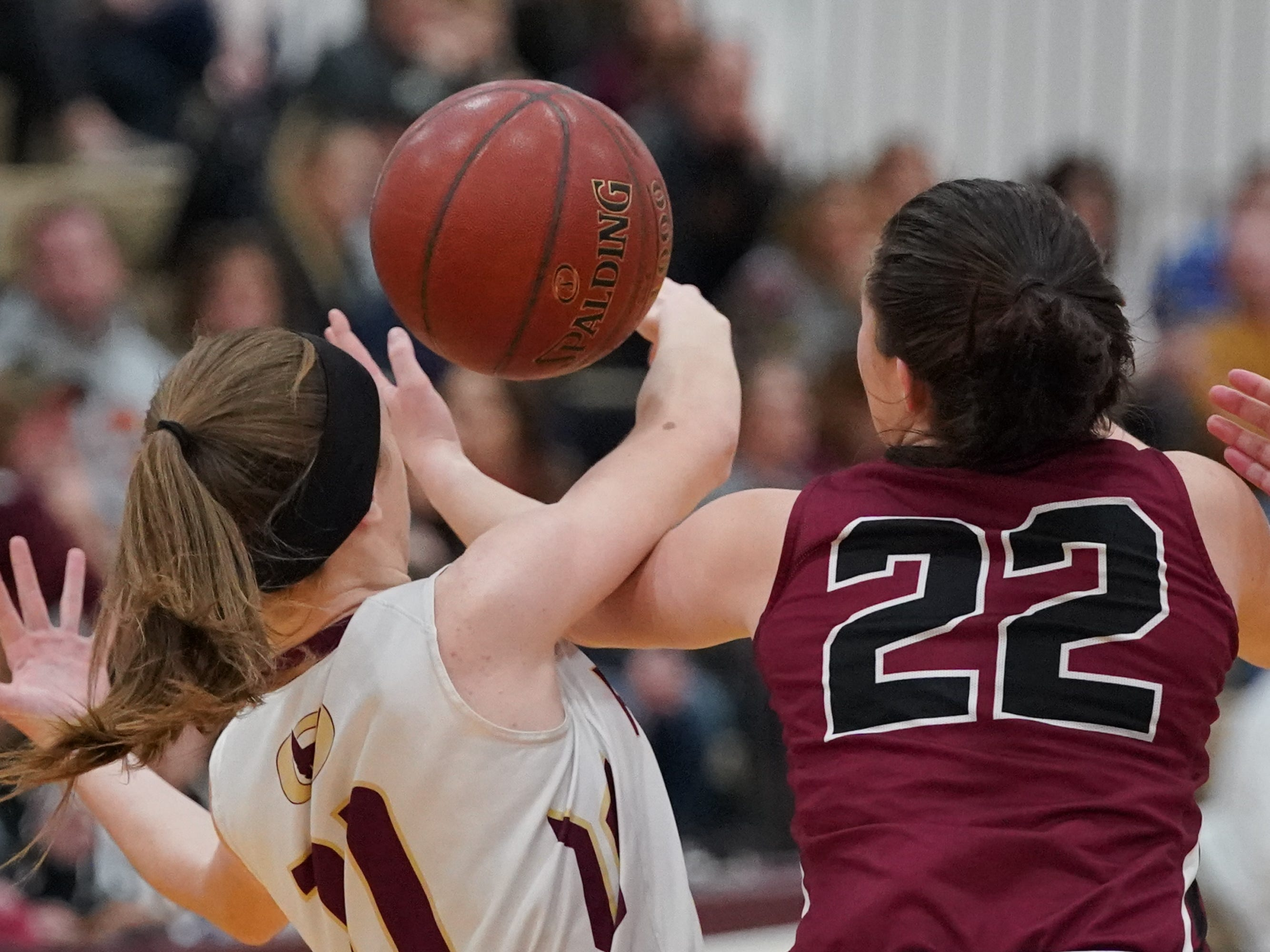 Danycka Milis (11) and Reannah Zimmer (22) battle for a rebound. The Omro Foxes hosted the Mayville Cardinals in a Flyway Conference basketball game Friday evening, January 4, 2019.