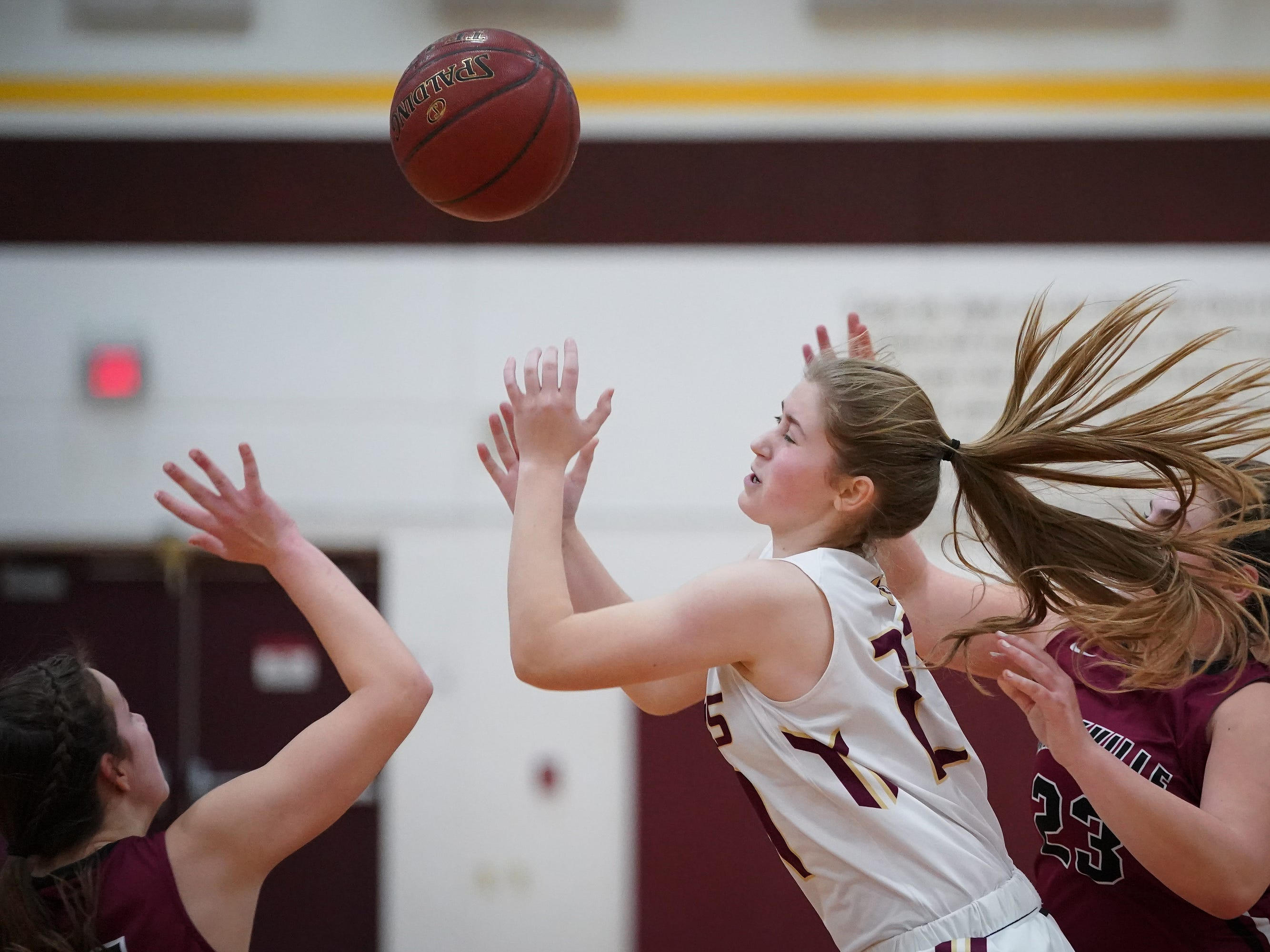 Tabitha Kilgas (21) of Omro fights for a rebound. The Omro Foxes hosted the Mayville Cardinals in a Flyway Conference basketball game Friday evening, January 4, 2019.