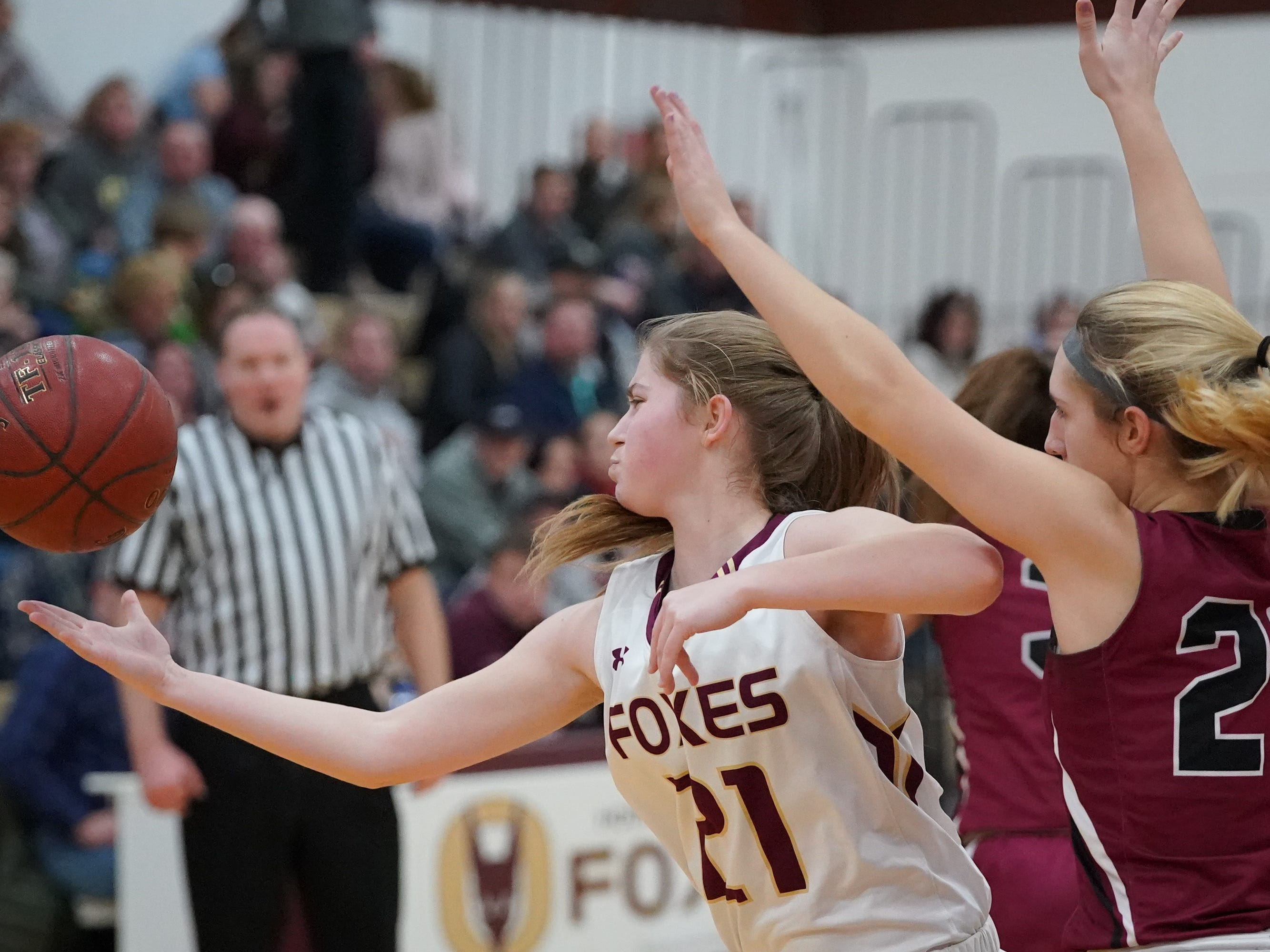Tabitha Kilgas (21) of Omro reaches for a rebound. The Omro Foxes hosted the Mayville Cardinals in a Flyway Conference basketball game Friday evening, January 4, 2019.