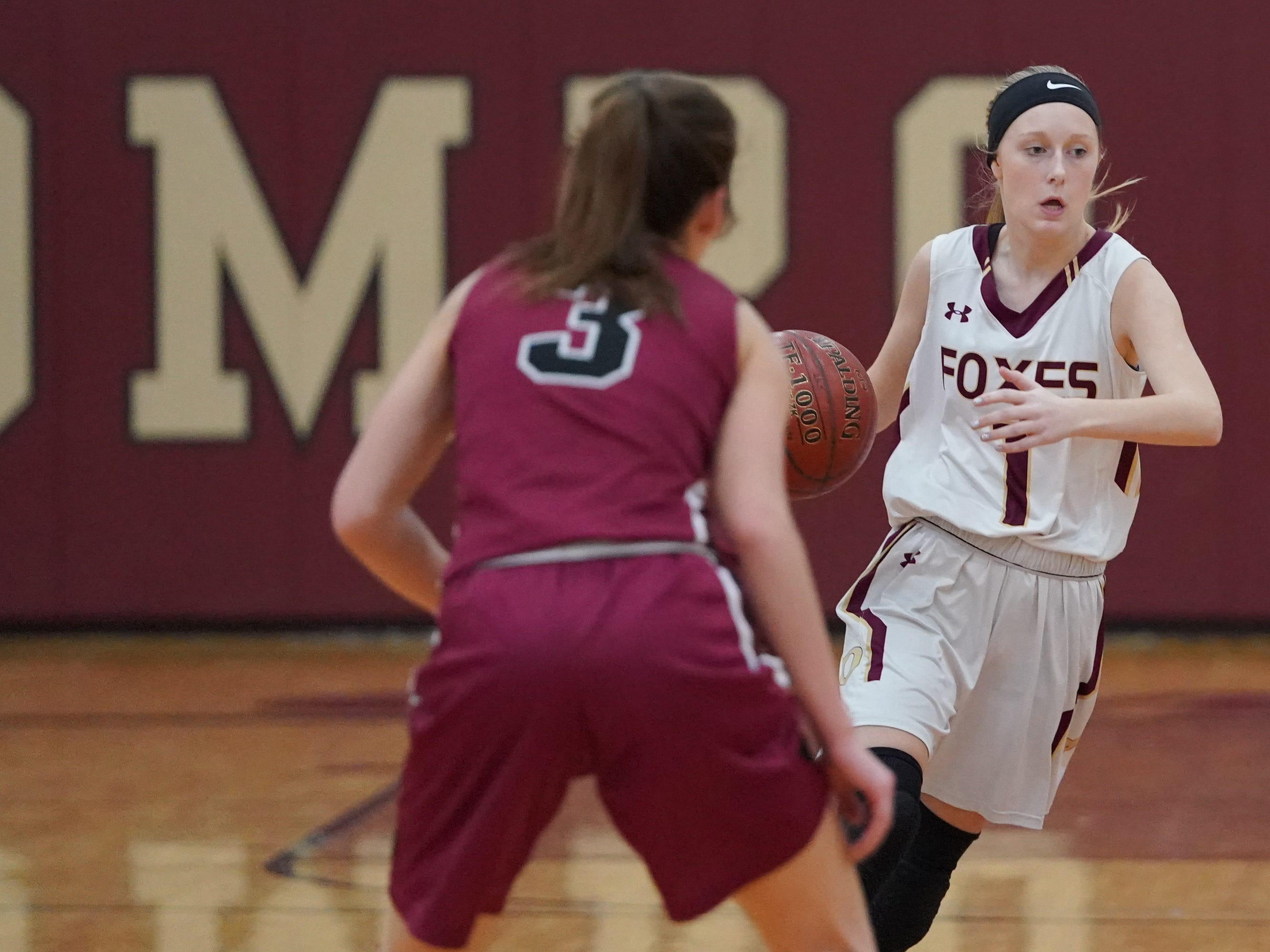 Amelia Eichmann (1) of Omro drives around Amber Schraufnagel (3) of Mayville. The Omro Foxes hosted the Mayville Cardinals in a Flyway Conference basketball game Friday evening, January 4, 2019.