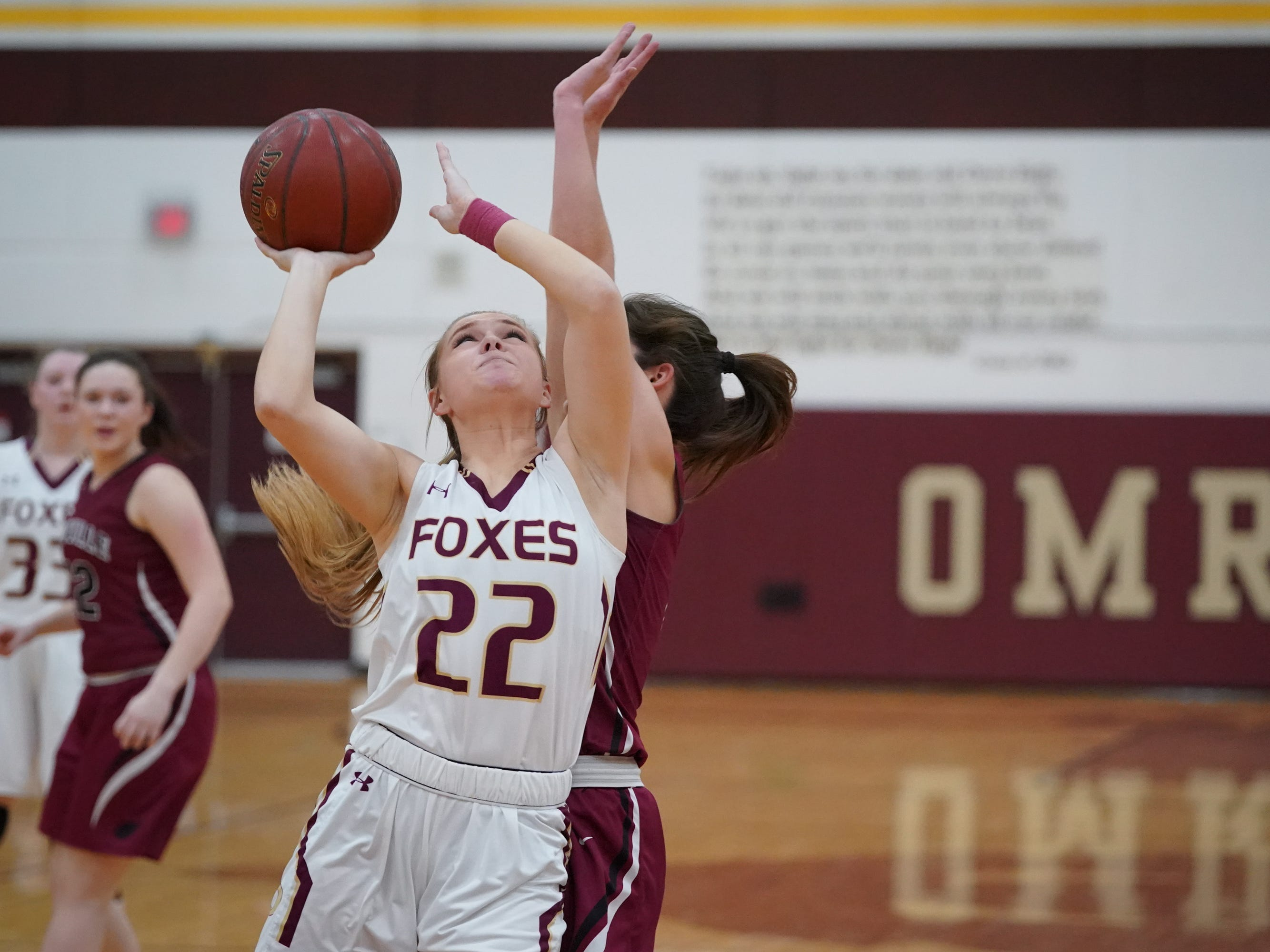 Jadyn Yonke (22) of Omro goes up for a shot. The Omro Foxes hosted the Mayville Cardinals in a Flyway Conference basketball game Friday evening, January 4, 2019.