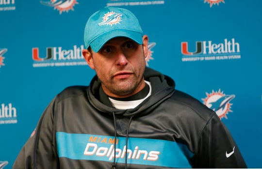 Miami Dolphins head coach Adam Gase answers questions during a news conference after an NFL football game against the Buffalo Bills, Sunday, Dec. 30, 2018, in Orchard Park, N.Y. The Bills won 42-17. (AP Photo/Jeffrey T. Barnes)