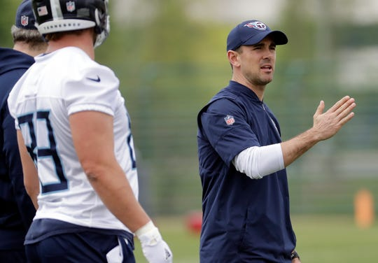 Tennessee Titans new offensive coordinator Matt LaFleur, right, explains a play during a voluntary practice at the team's NFL football training facility Wednesday, April 25, 2018, in Nashville, Tenn. (AP Photo/Mark Humphrey)
