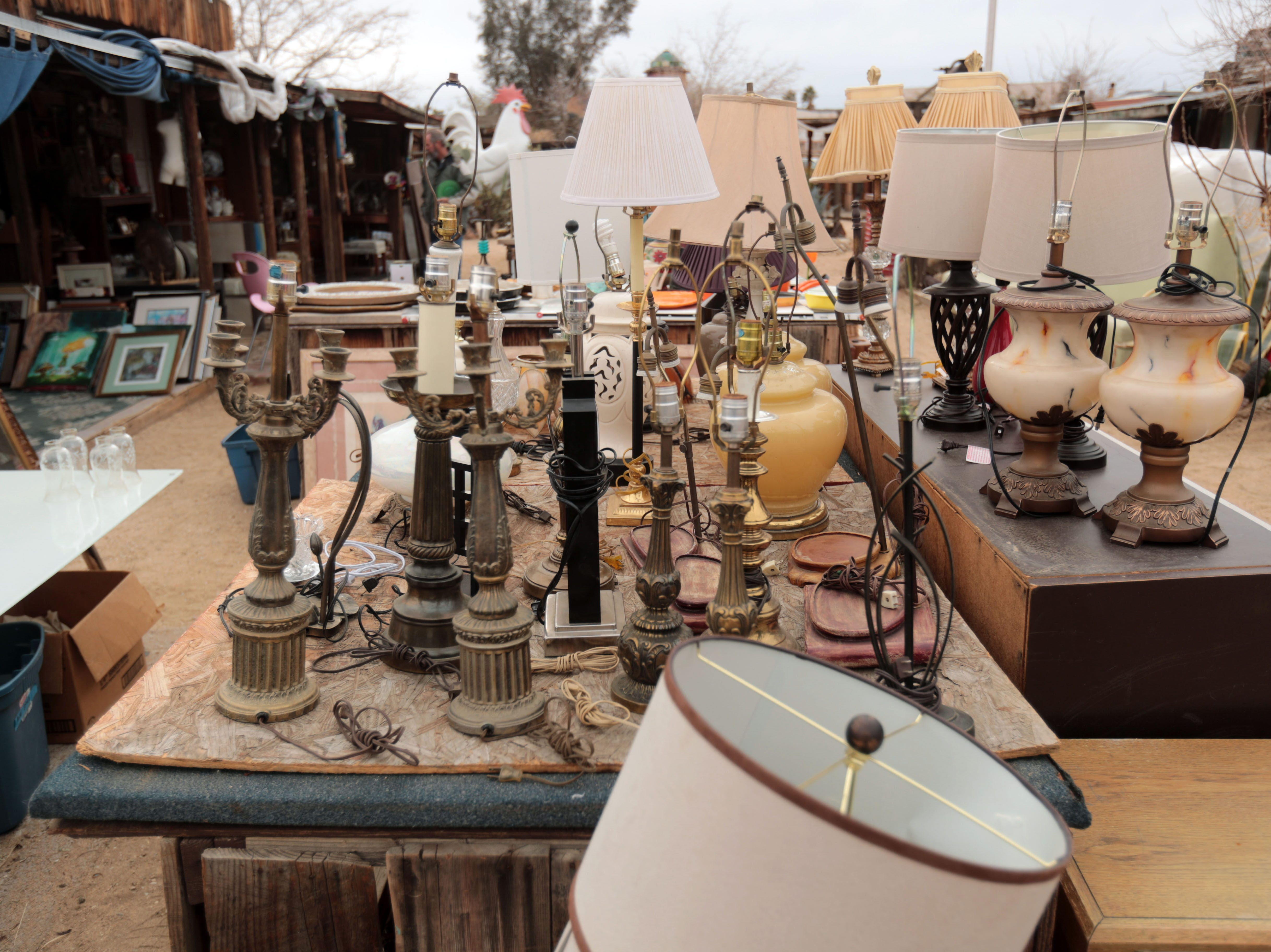 A collection of lamp stands for sale at the Sky Village Swap Meet in Yucca Valley on Saturday, January 5, 2019.