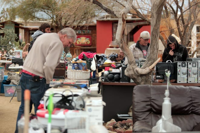 Shoppers and venders look through the goods at the Sky Village Swap Meet in Yucca Valley on Saturday, January 5, 2019.