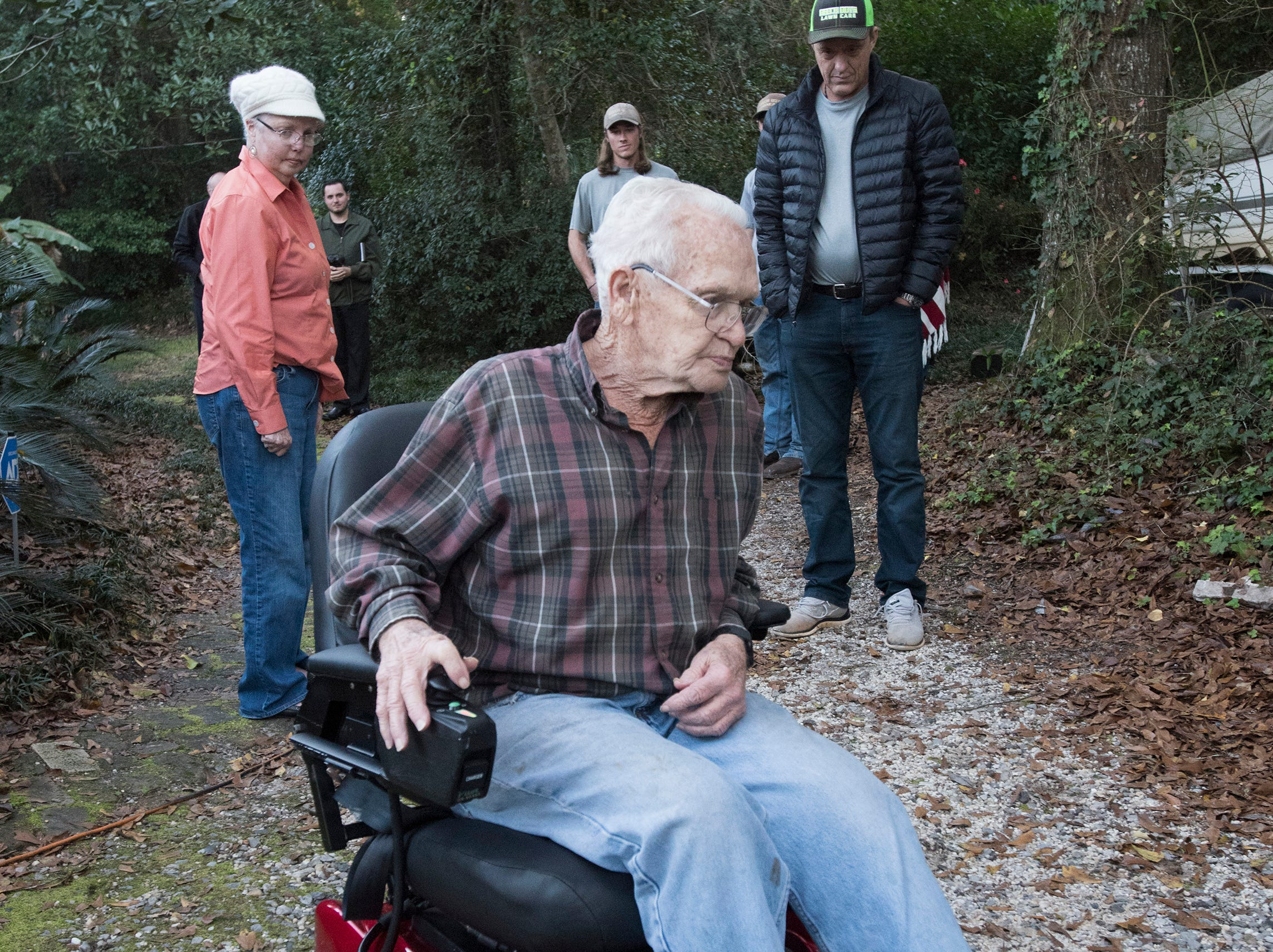 East Milton resident, Jim Blazier, takes his new motorized chair for a spin outside his home on Friday, Jan. 4, 2019, while his wife Phyllis, and Rick Beech look on.  Blazier and his wife received the restored chair as a gift from Rick Beech, the owner of Beech Boys Lawn Care.