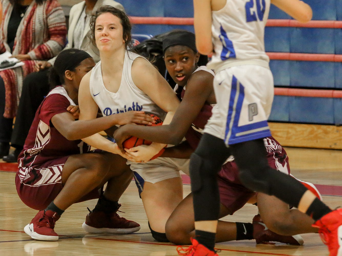 Pace's Paiten Rivera, center, and PHS' Nala Baker, left, and Shy'Kera Miller battle for control of the ball on the floor at Pace High School on Friday, January 4, 2019.