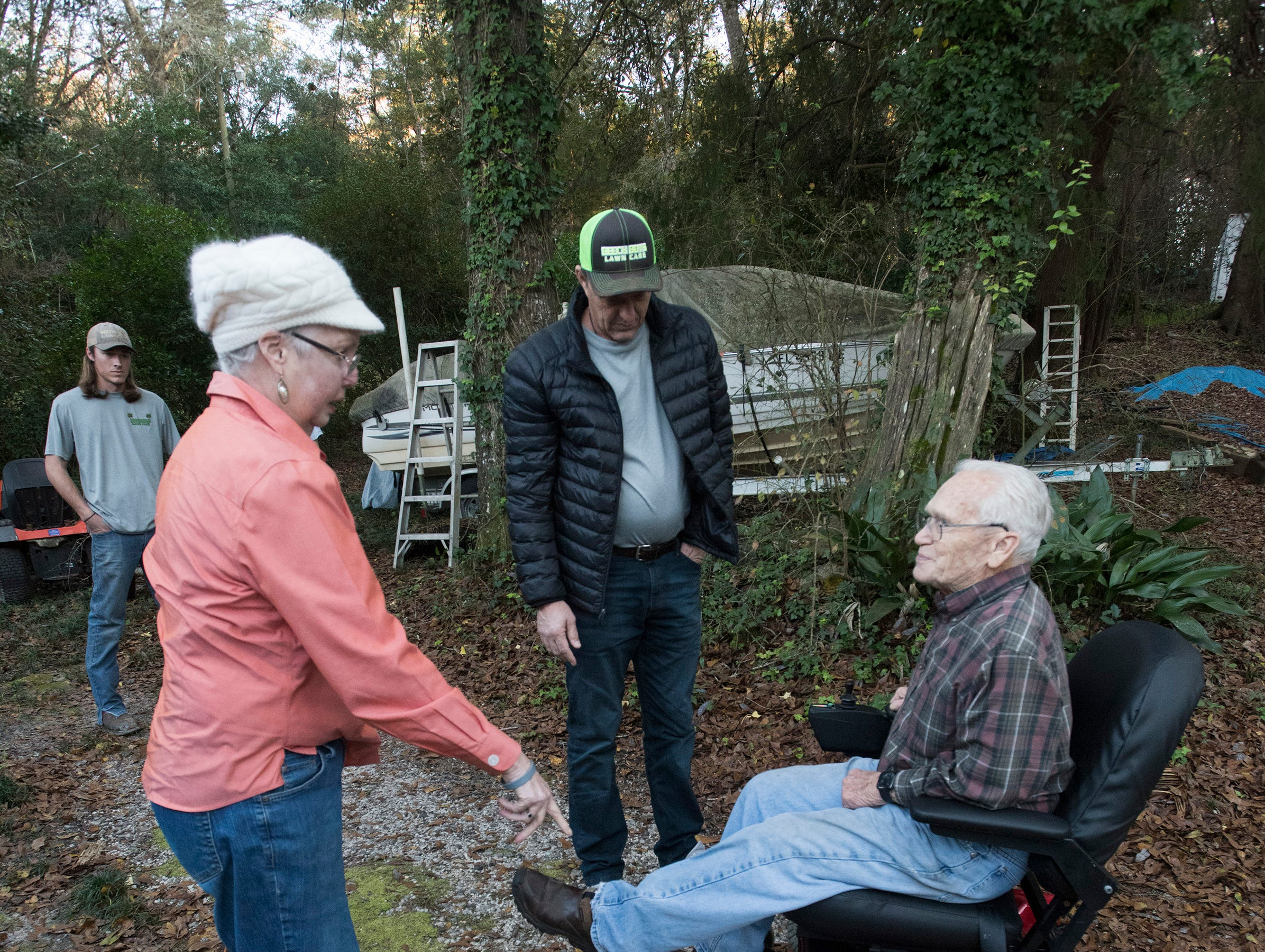 East Milton resident, Jim Blazier, prepares to take his new motorized chair for a spin outside his home on Friday, Jan. 4, 2019, while his wife Phyllis, and Rick Beech, look on.  Blazier and his wife received the restored chair as a gift from Rick Beech, the owner of Beech Boys Lawn Care.