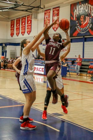 PHS' Nala Baker (11) goes up for a layup against the Patriots at Pace High School on Friday, January 4, 2019.