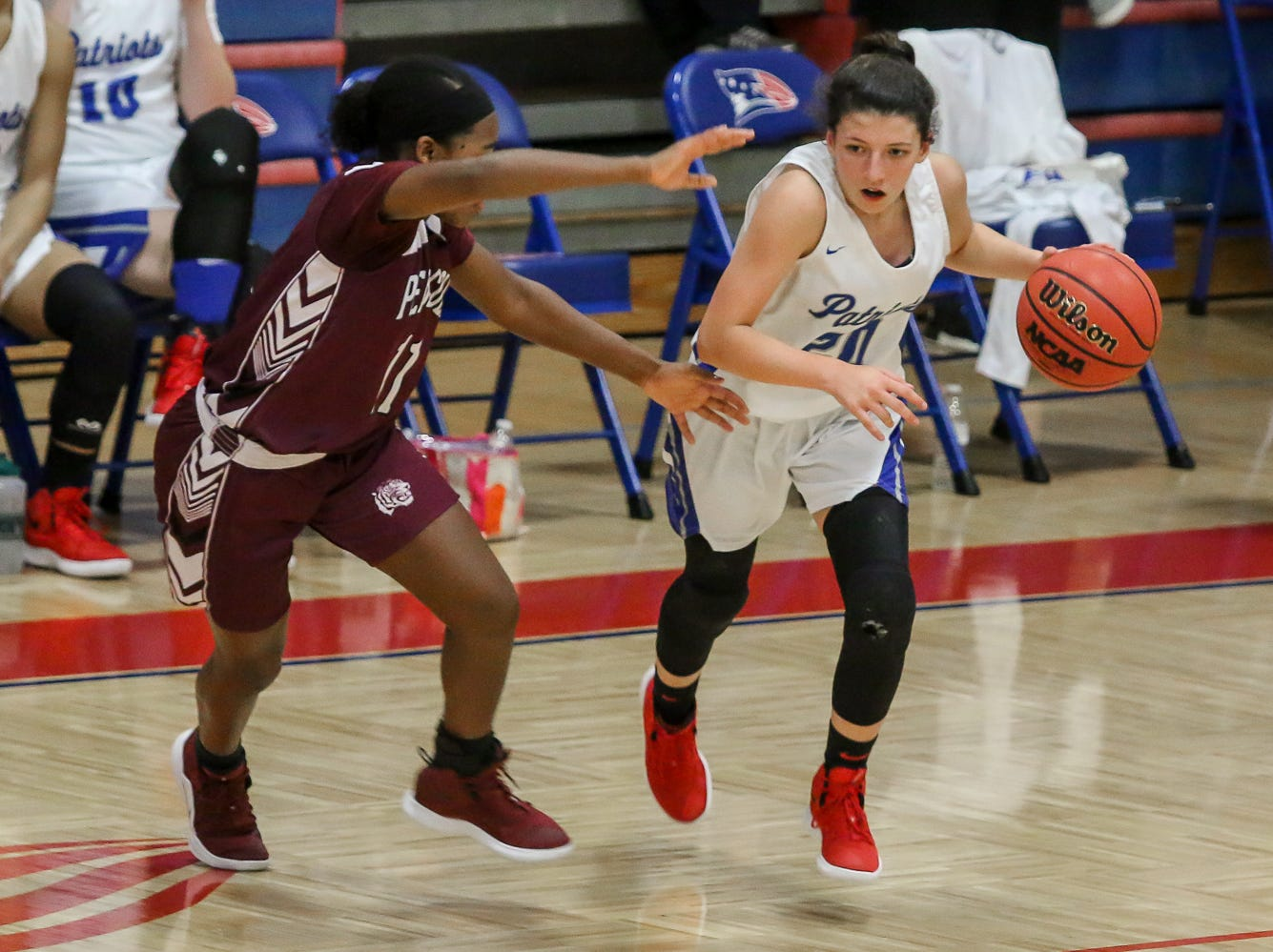 Pace's Shay Crooks (20) works to move the ball up the court against PHS' Nala Baker (11) at Pace High School on Friday, January 4, 2019.