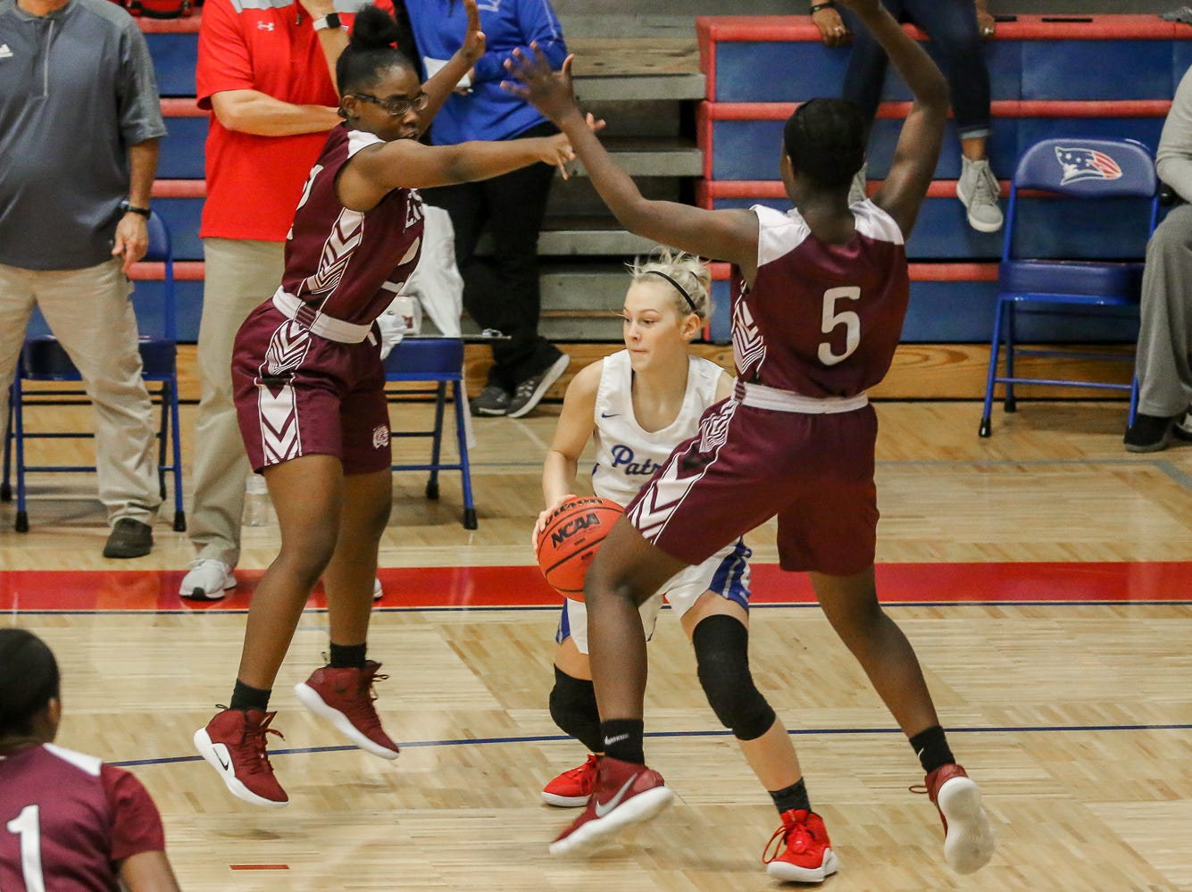 Pace's Laikyn Burklow (3) looks for an opening to squeeze through PHS' Shy'Kera Miller (5) and Amonei Wiggins (22) at Pace High School on Friday, January 4, 2019.