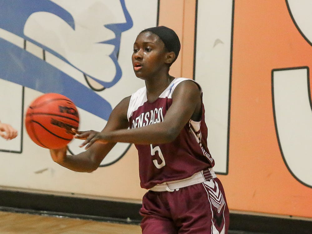 PHS' Shy'Kera Miller (5) passes the ball against the Patriots at Pace High School on Friday, January 4, 2019.