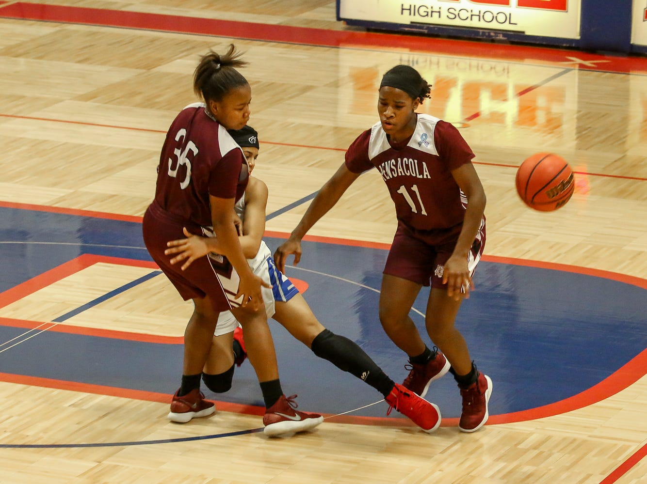 Pace's Cyla Byrd (15) collides with Joniya Perry (35) after getting tripped up by PHS' Nala Baker (11) at Pace High School on Friday, January 4, 2019.