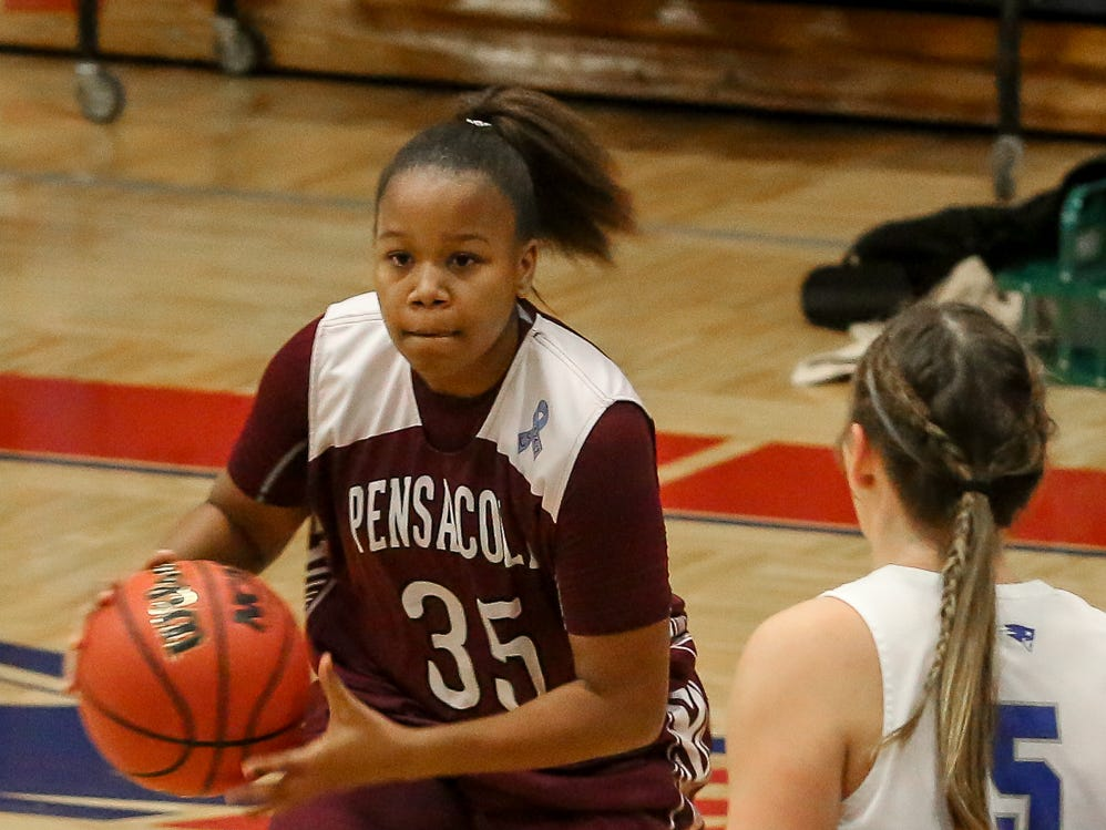 PHS' Joniya Perry (35) looks to pass the ball past Pace's Violette Skipworth (5) at Pace High School on Friday, January 4, 2019.