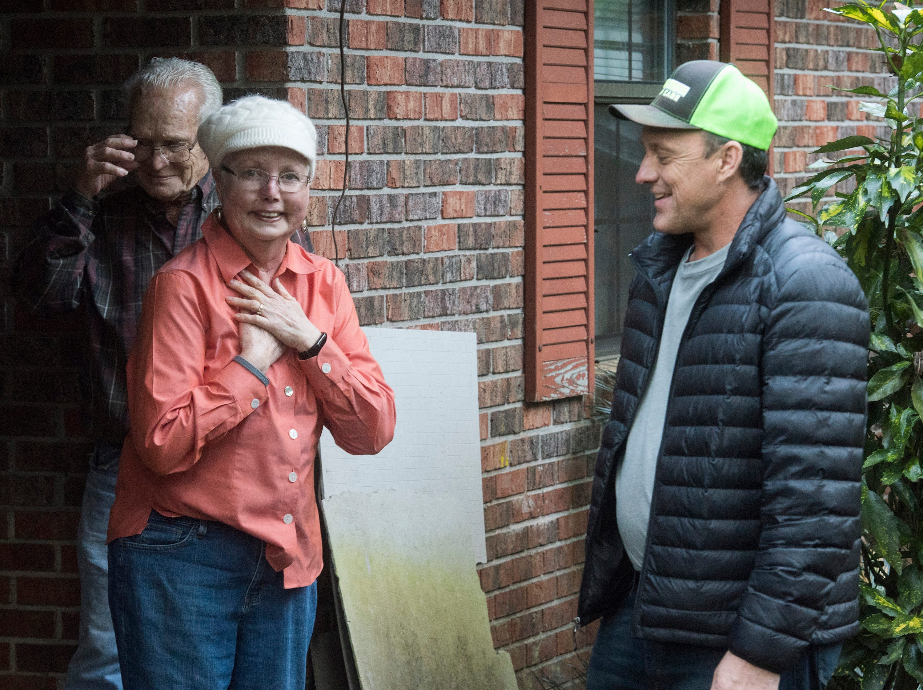 East Milton resident, Phyllis and Jim Blazier, are overcome with emotion after a surprise delivery of a motorized chair to their home on Friday, Jan. 4, 2019, while Rick Beech, the owner of Beech Boys Lawn Care, looks on. Beech delivered the gift after learning of the couple's need via Facebook.