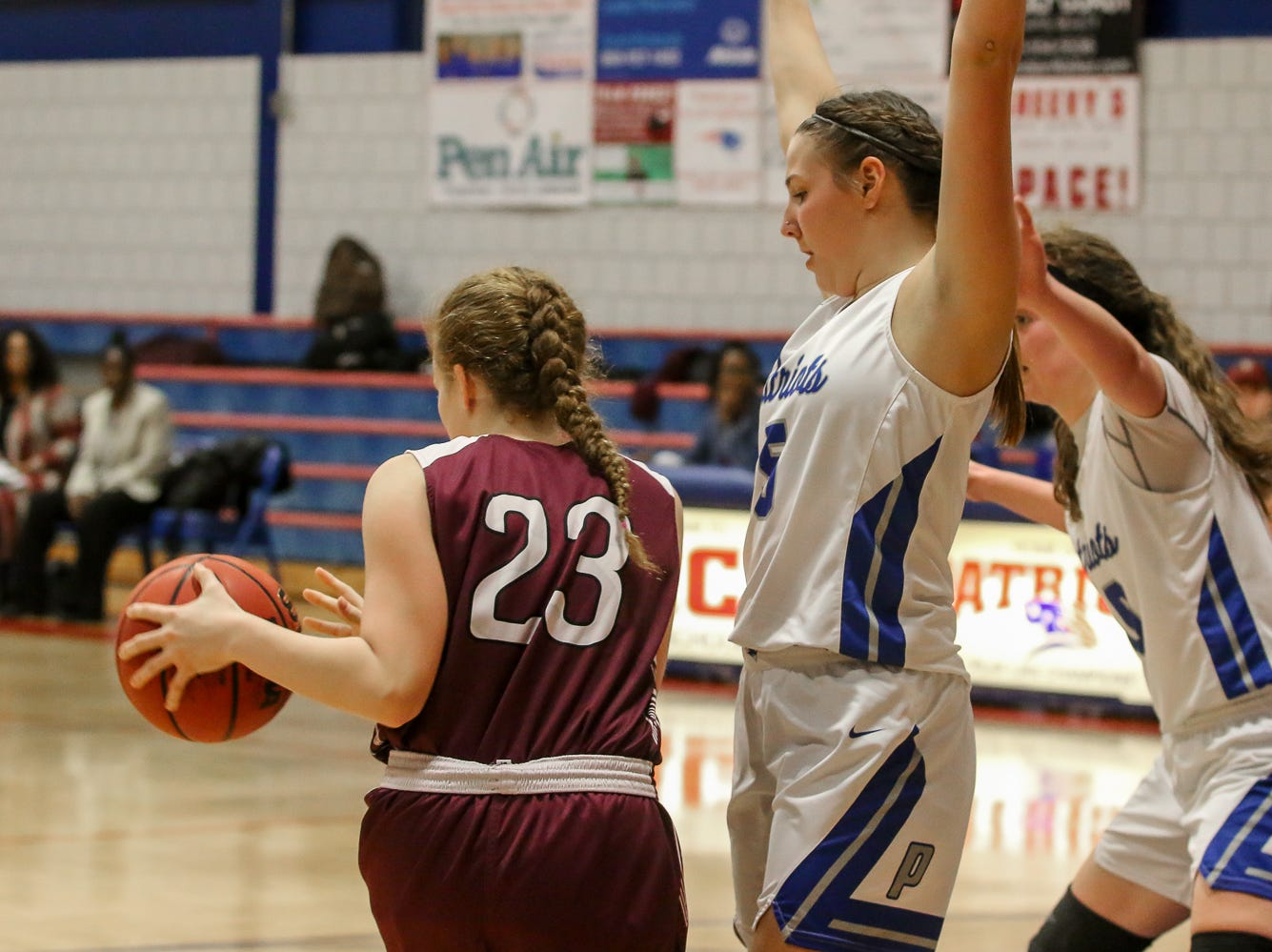 PHS' Sophia Litchfield (23) changes direction after being blocked by Pace's Violette Skipworth (5) at Pace High School on Friday, January 4, 2019.