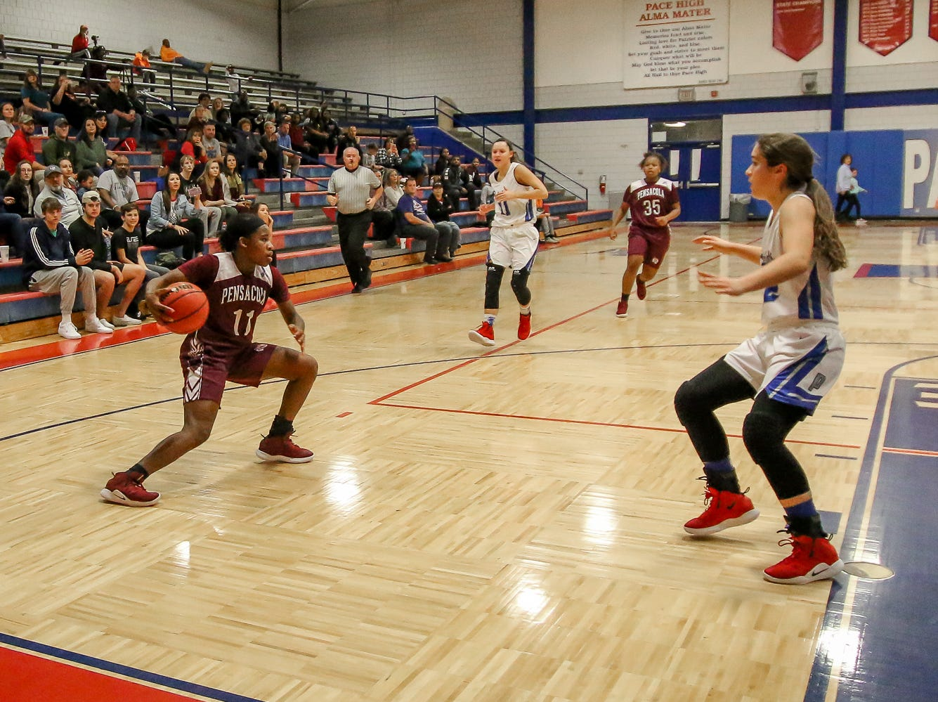 PHS' Nala Baker (11) cuts back to her left to move around the Pace defense at Pace High School on Friday, January 4, 2019.