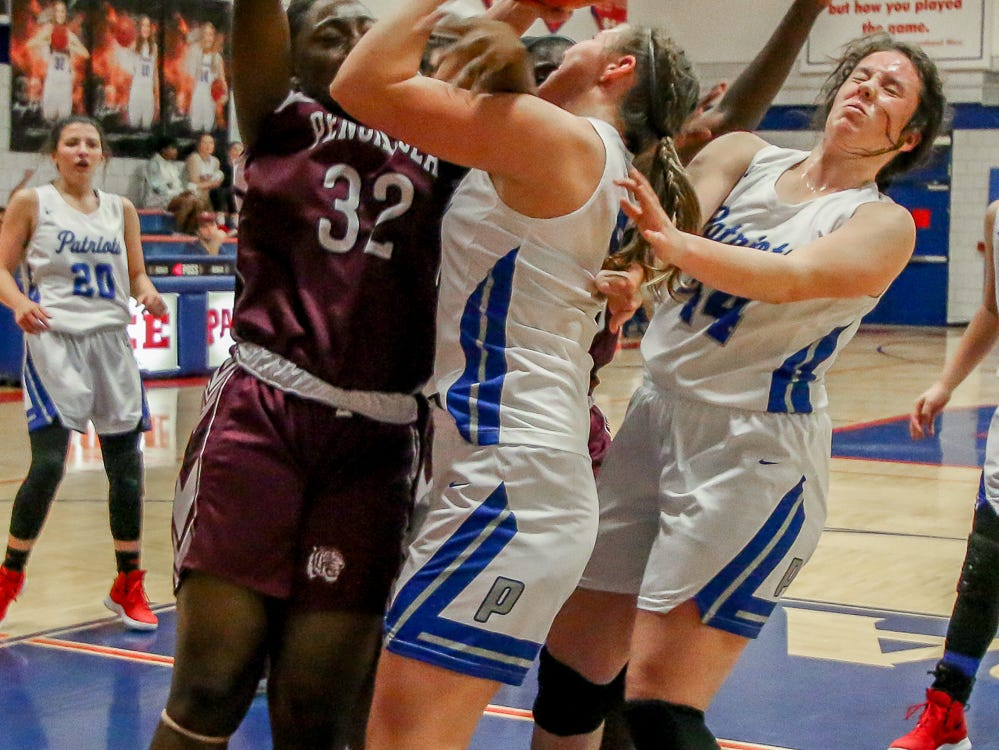 Pace's Violette Skipworth (5) tries to maintain control of the ball as PHS's Caitlin Wheeler (32) tries to knock it out of her hands at Pace High School on Friday, January 4, 2019.