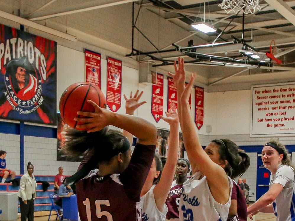 Pensacola High's Ja'Nya Hall (15) tries to clear the ball from under the Patriots' net at Pace High School on Friday, January 4, 2019.
