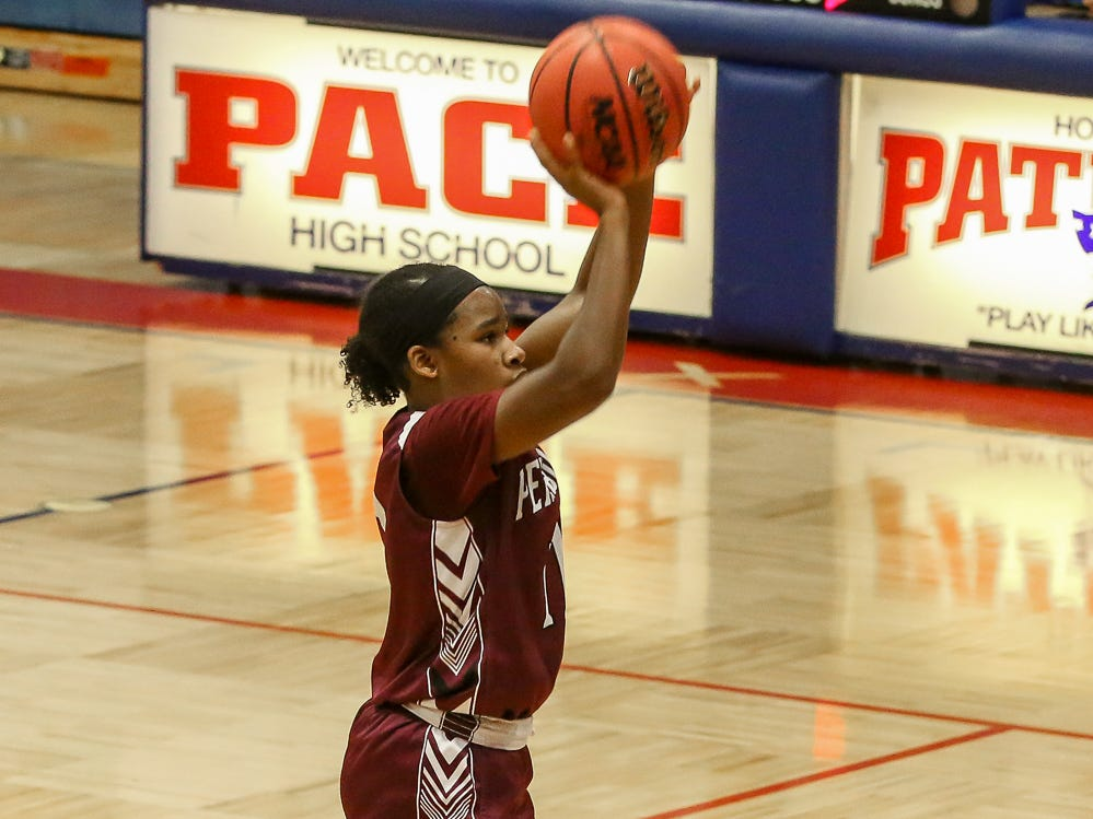 PHS' Nala Baker (11) takes a shot against the Patriots at Pace High School on Friday, January 4, 2019.