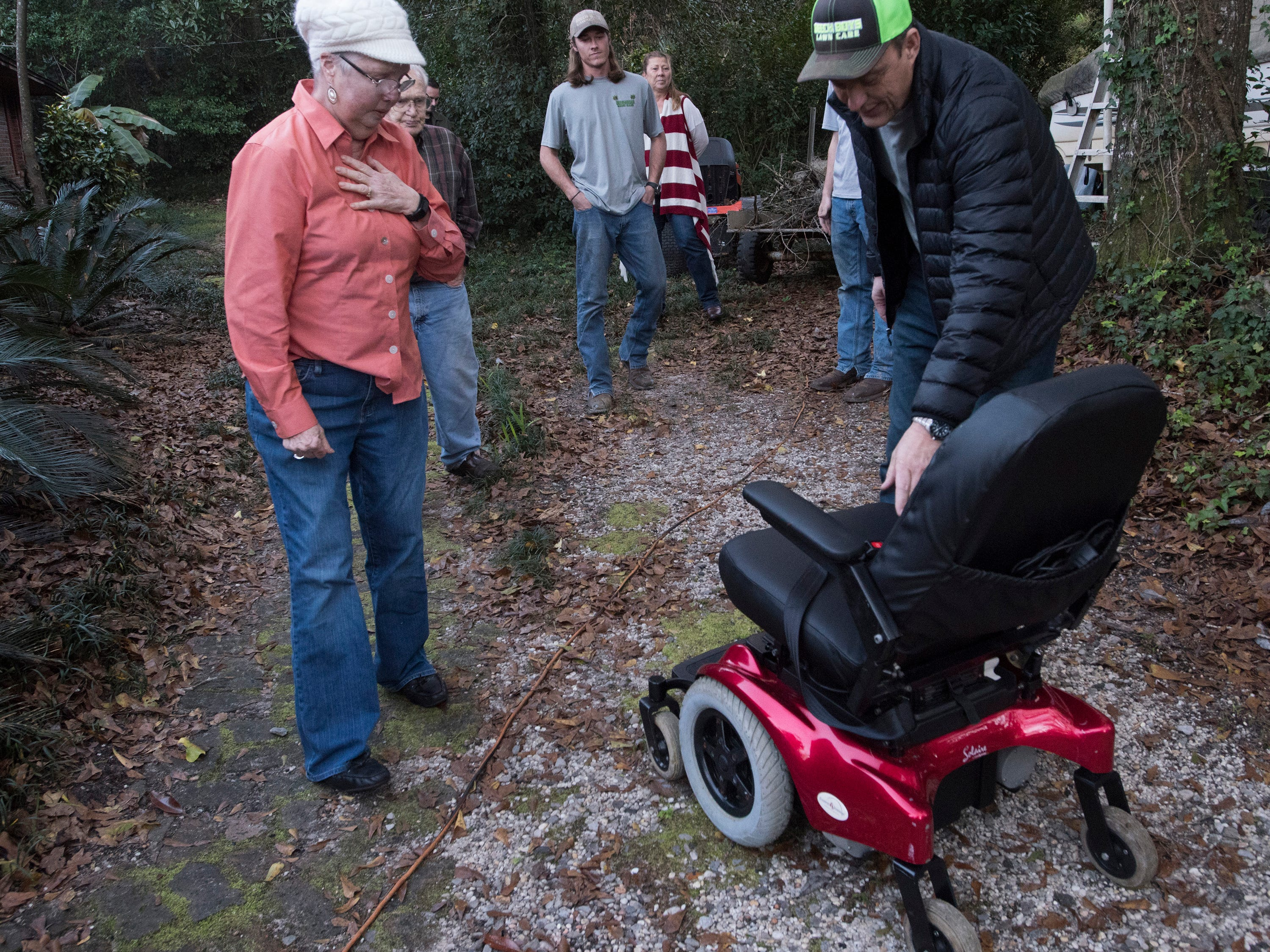 Rick Beech, the owner of Beech Boys Lawn Care, presents East Milton residents, Phyllis, and Jim Blazier, with a refurbished motorized chair on Friday, Jan. 4, 2019