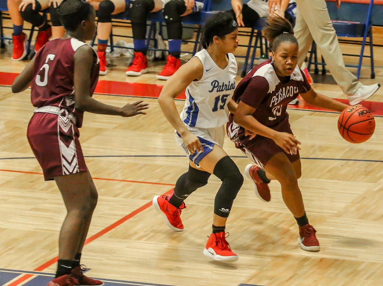 PHS' Joniya Perry (35) slides around Pace's Cyla Byrd (15) on her way toward the basket at Pace High School on Friday, January 4, 2019.