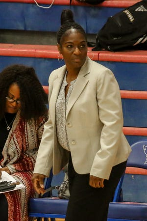Pensacola High head coach Alison Davis watches as her team takes on the Patriots at Pace High School on Friday, January 4, 2019.