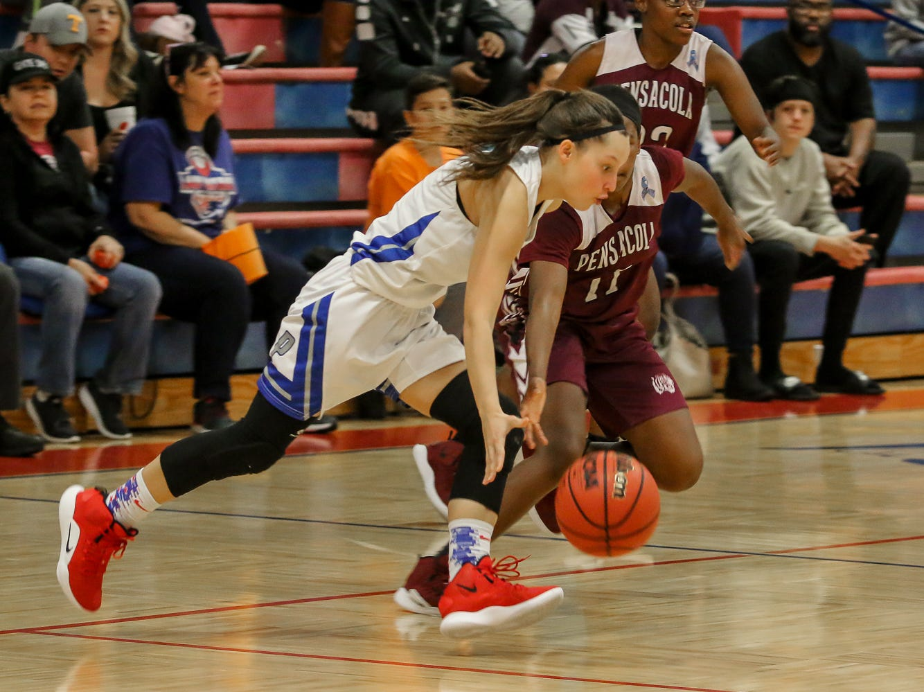 Pace's Katie Brabham (11) dribbles the ball around PHS' Nala Baker (11) at Pace High School on Friday, January 4, 2019.