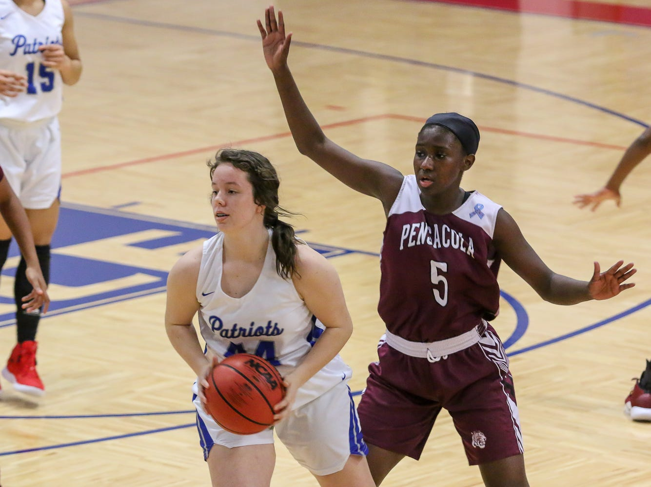 Pace's Paiten Rivera (44) turns and looks for a teammate to pass the ball to as PHS' Shy'Kera Miller (5) defends against her at Pace High School on Friday, January 4, 2019.