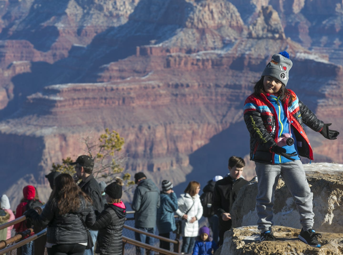 9-year-old Dylan La poses for a photo at Grand Canyon National Park on Jan. 4, 2019. The park was staffed at minimum capacity due to the government shutdown but retained much of its services due to an executive order issued by Arizona Gov. Doug Ducey to run the park with state funds in the event of a shutdown.