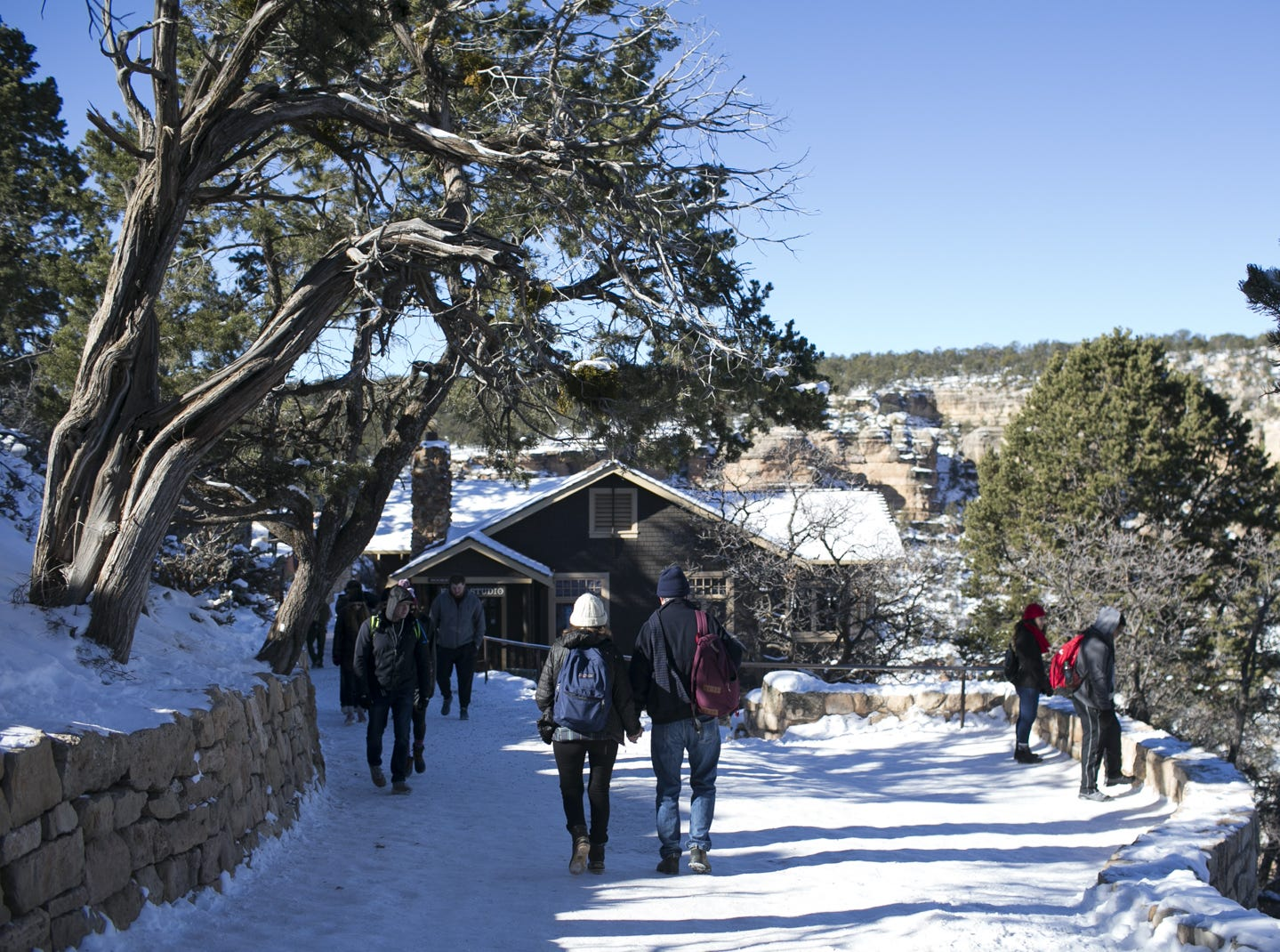 Visitors enjoy the winter weather at Grand Canyon National Park on Jan. 4, 2019. The park was staffed at minimum capacity due to the government shutdown but retained much of its services due to an executive order issued by Arizona Gov. Doug Ducey to run the park with state funds in the event of a shutdown.