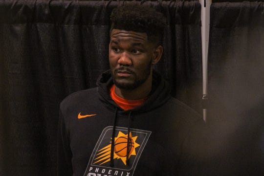 DeAndre Ayton, a Pheonix Sun's player, listins to the public speak during a public hearing to discuss the pending renovation cost for Talking Stick Resort Arena in Phoenix, Arizona on Saturday, Jan. 5, 2018.