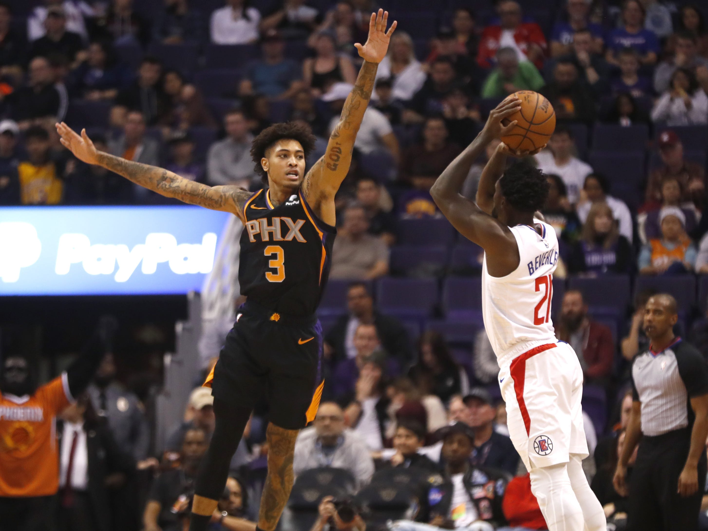 Suns' Kelly Oubre Jr. (3) contests a three pointer from Clippers' Patrick Beverley (21) during the first half at Talking Stick Resort Arena in Phoenix, Ariz. on January 4, 2019.