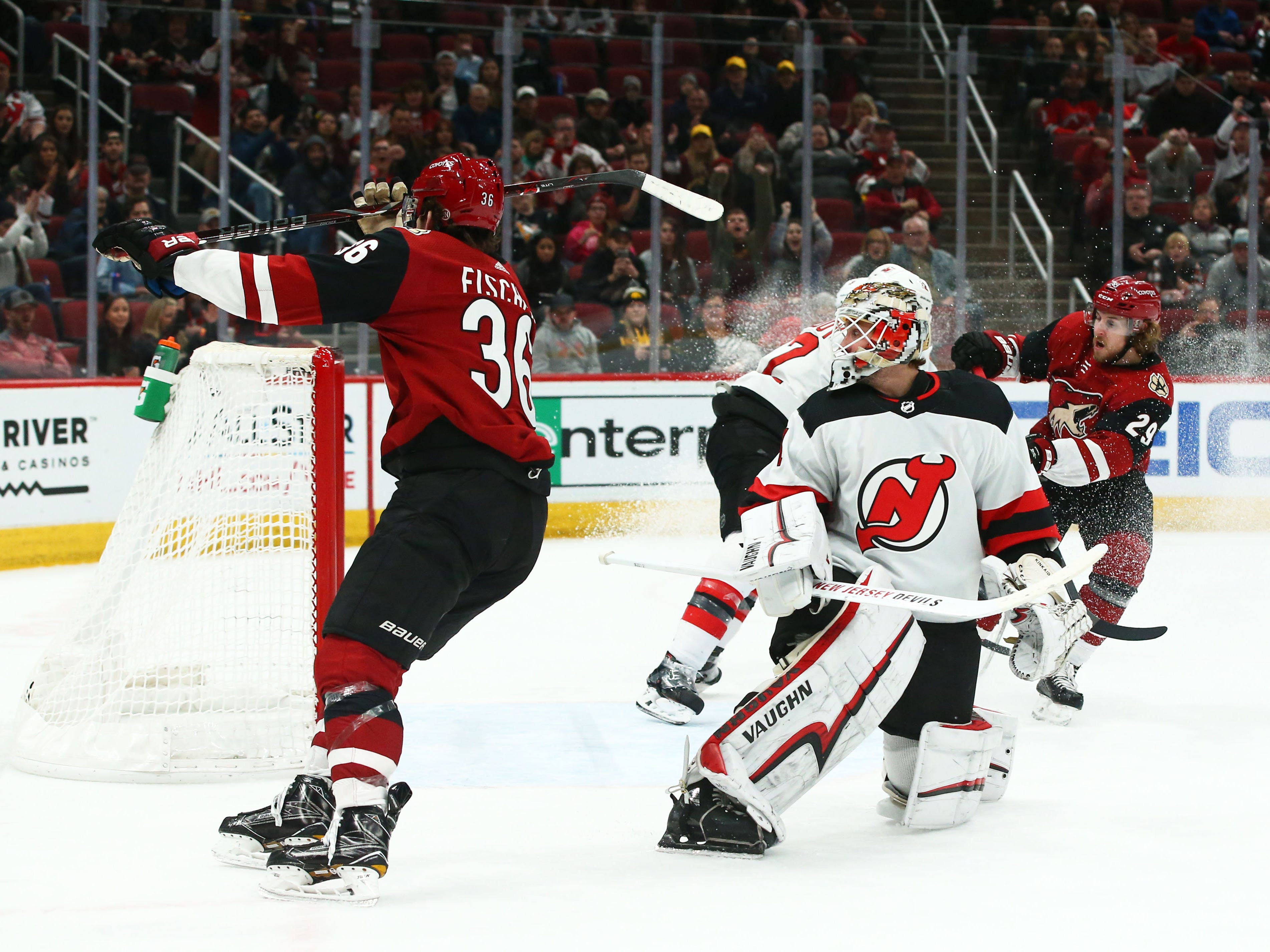 Arizona Coyotes' Christian Fischer (36) scores a goal against the New Jersey Devils in the second period on Jan. 4 at Gila River Arena.