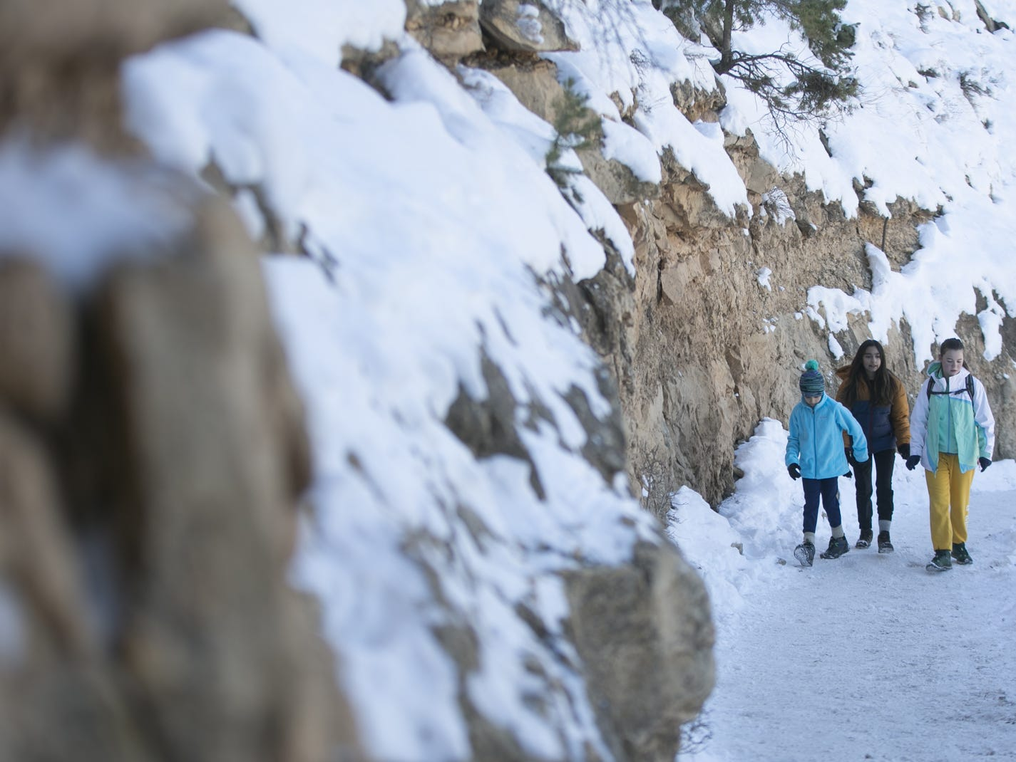 10-year-old Zara Ayala (left), 13-year-old Kayla Ayala (center) and 13-year-old Natalie O'Neill (right), visiting from Austin, Texas, hike along the Bright Angel Trail at Grand Canyon National Park on Jan. 4, 2019. The park was staffed at minimum capacity due to the government shutdown but retained much of its services due to an executive order issued by Arizona Gov. Doug Ducey to run the park with state funds in the event of a shutdown.