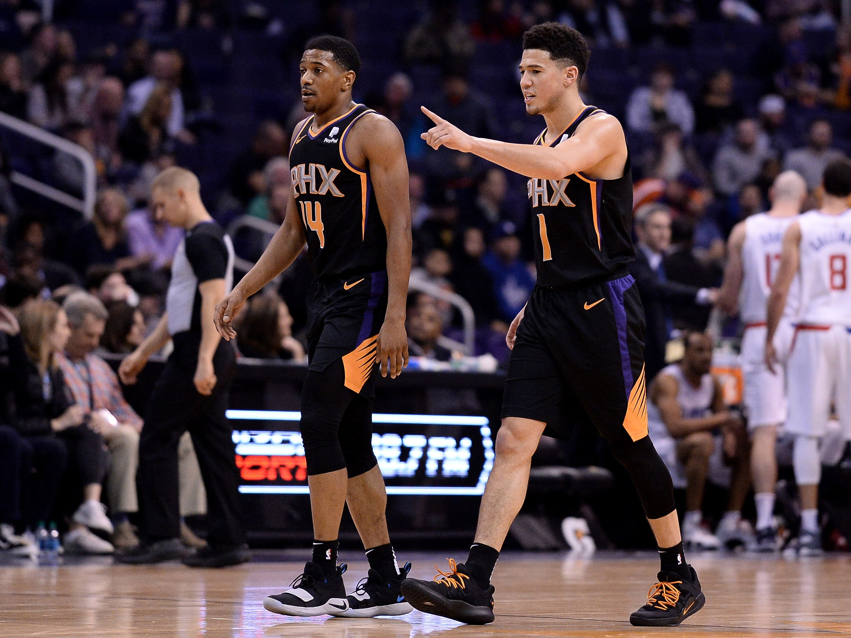 Jan 4, 2019; Phoenix, AZ, USA; Phoenix Suns guard De'Anthony Melton (14) and guard Devin Booker (1) react during a time out in the first half against the LA Clippers at Talking Stick Resort Arena. Mandatory Credit: Jennifer Stewart-USA TODAY Sports