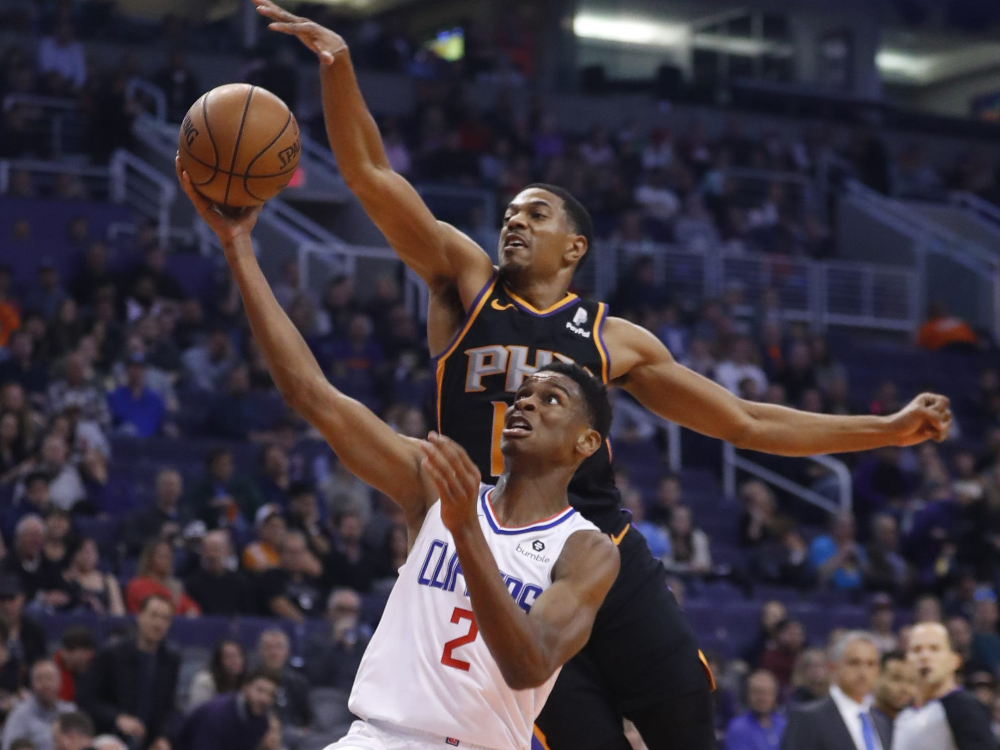 Suns' De'Anthony Melton (14) blocks Clippers' Shai Gilgeous-Alexander (2) during the second half at Talking Stick Resort Arena in Phoenix, Ariz. on January 4, 2019.