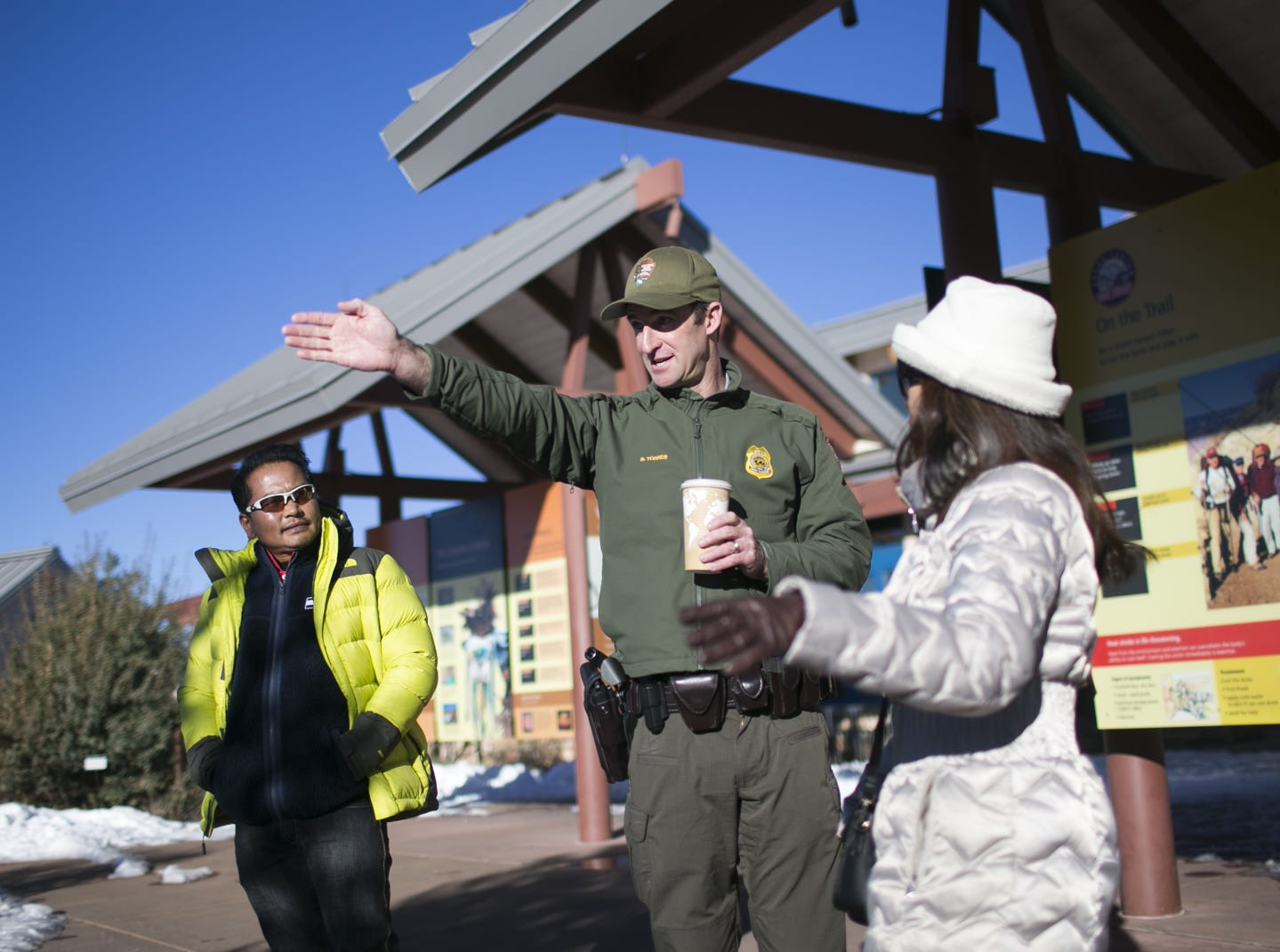 Brandon Torres (center), the Branch Chief of Emergency Services at Grand Canyon National Park, directs guests in the park on Jan. 4, 2019. The park was staffed at minimum capacity due to the government shutdown but retained much of its services due to an executive order issued by Arizona Gov. Doug Ducey to run the park with state funds in the event of a shutdown.