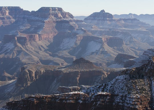 Snows rests on peaks at Grand Canyon National Park on Jan. 4, 2019. The park was staffed at minimum capacity due to the government shutdown but retained much of its services due to an executive order issued by Arizona Gov. Doug Ducey to run the park with state funds in the event of a shutdown.