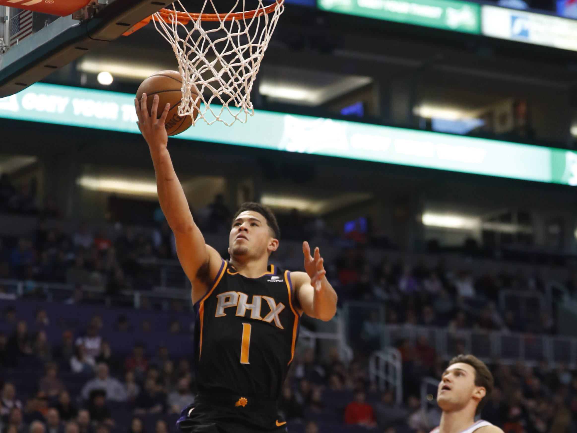 Suns' Devin Booker (1) scores a layup against the Clippers during the first half at Talking Stick Resort Arena in Phoenix, Ariz. on January 4, 2019.