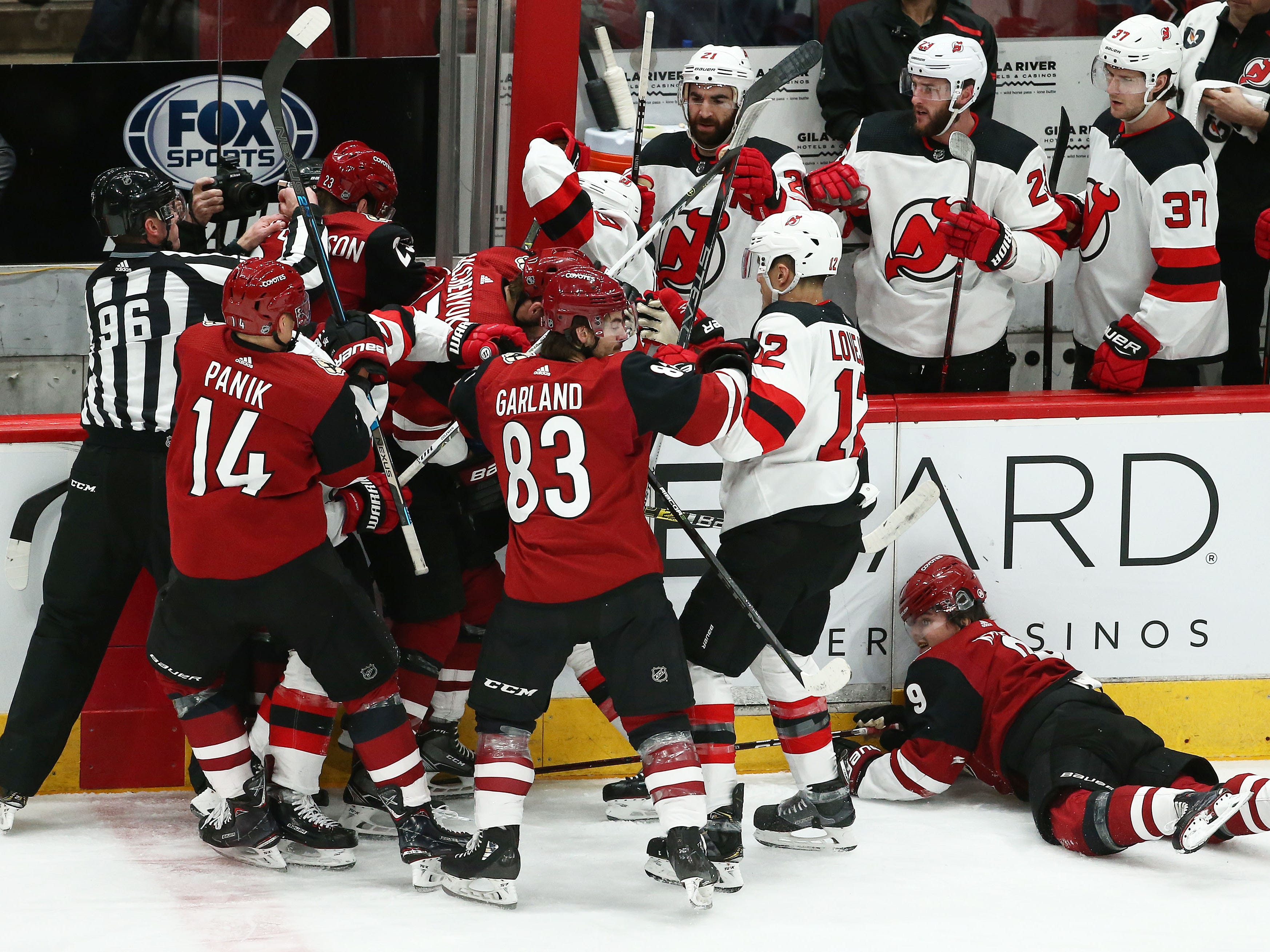 Arizona Coyotes' Clayton Keller is driven into the boards which started a fight with New Jersey Devils in the 1st period on Jan. 4 at Gila River Arena.