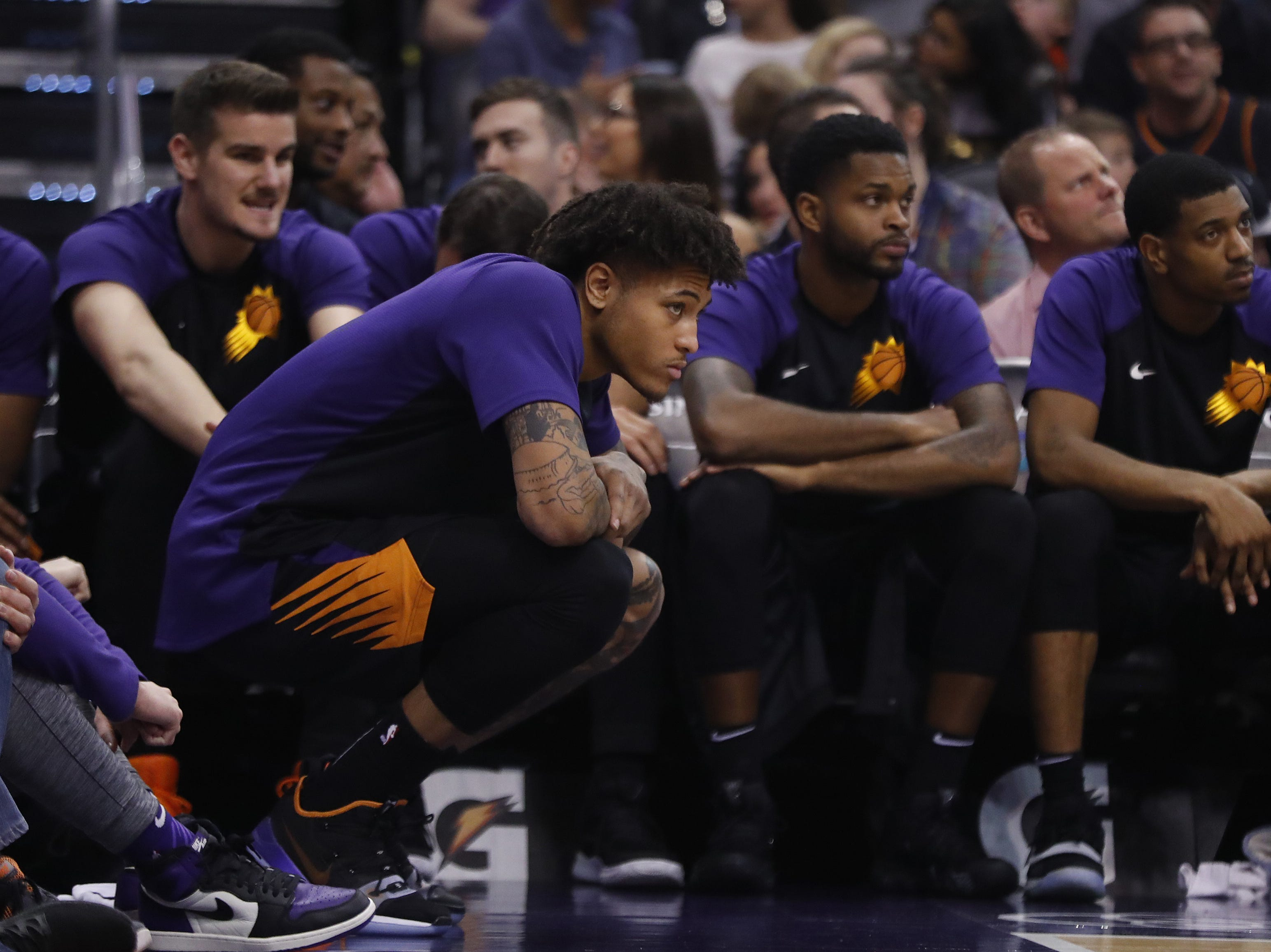 Suns' Kelly Oubre Jr. watches the court from the bench during the second half against the Clippers at Talking Stick Resort Arena in Phoenix, Ariz. on January 4, 2019.