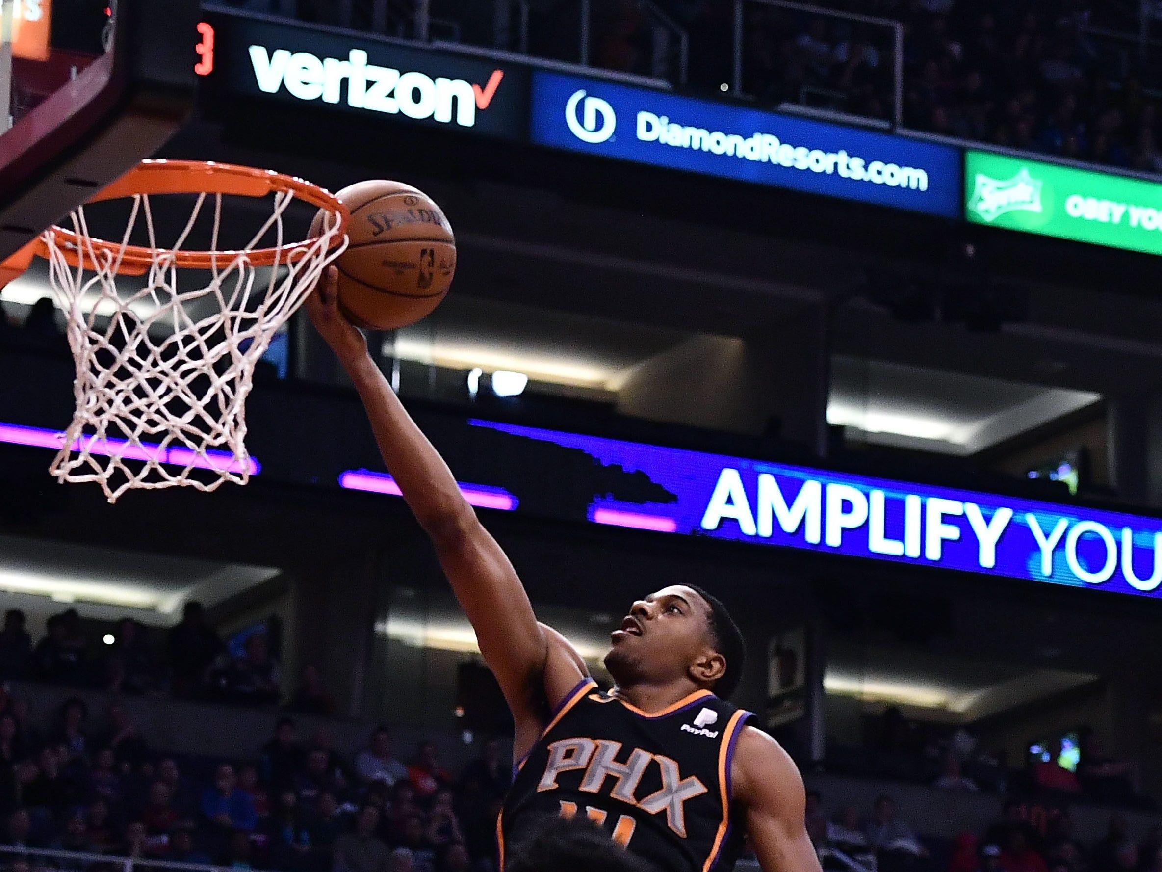 Jan 4, 2019; Phoenix, AZ, USA; Phoenix Suns guard De'Anthony Melton (14) shoots the ball against the LA Clippers in the first half at Talking Stick Resort Arena. Mandatory Credit: Jennifer Stewart-USA TODAY Sports