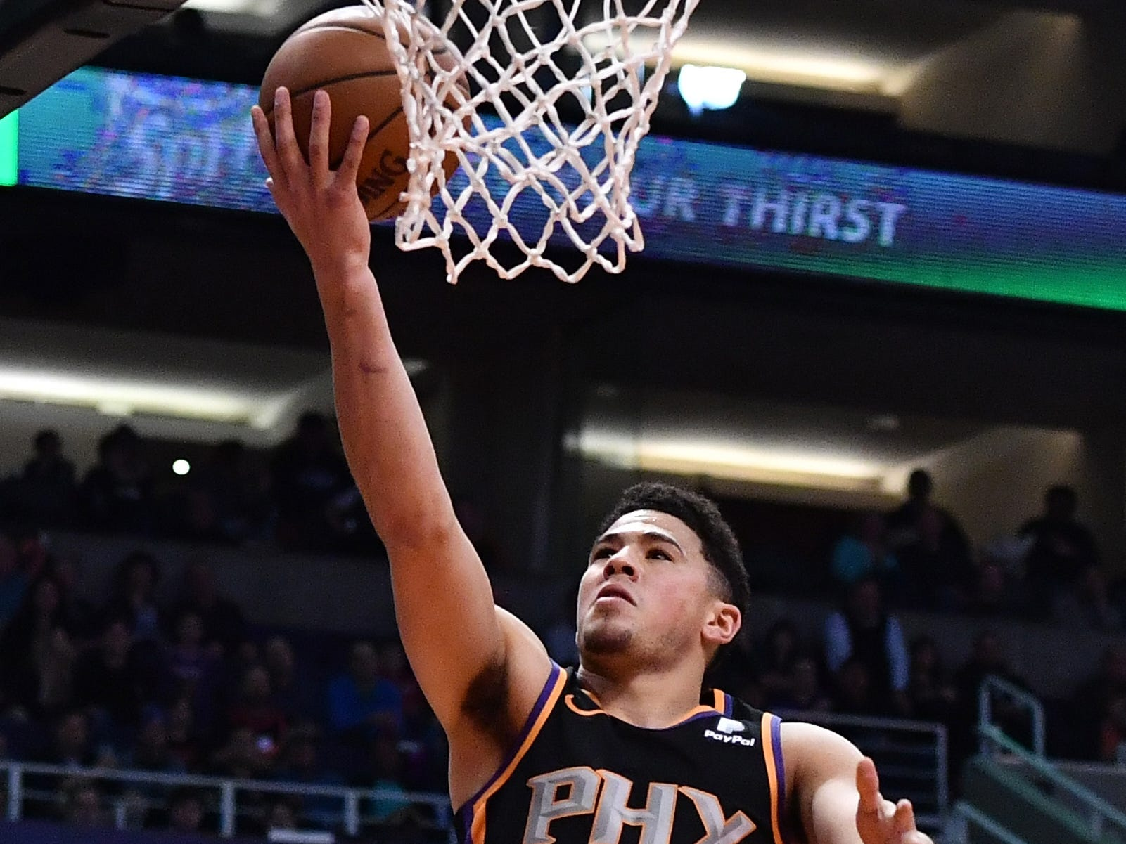 Jan 4, 2019; Phoenix, AZ, USA; Phoenix Suns guard Devin Booker (1) lays up the ball in the first half against the LA Clippers at Talking Stick Resort Arena. Mandatory Credit: Jennifer Stewart-USA TODAY Sports